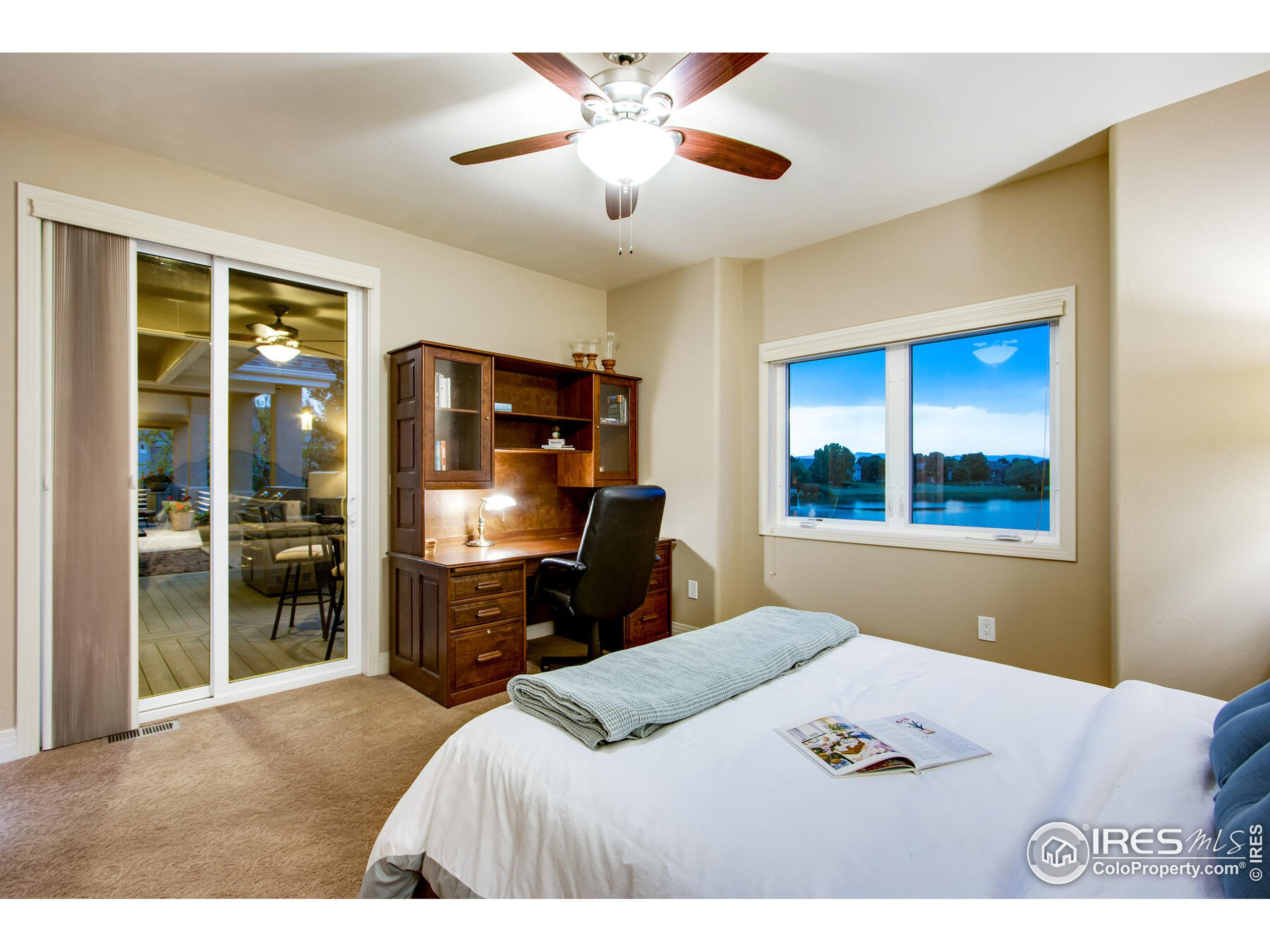 Main floor oversized bedroom # 2 with walk-in closet & private access to upper balcony