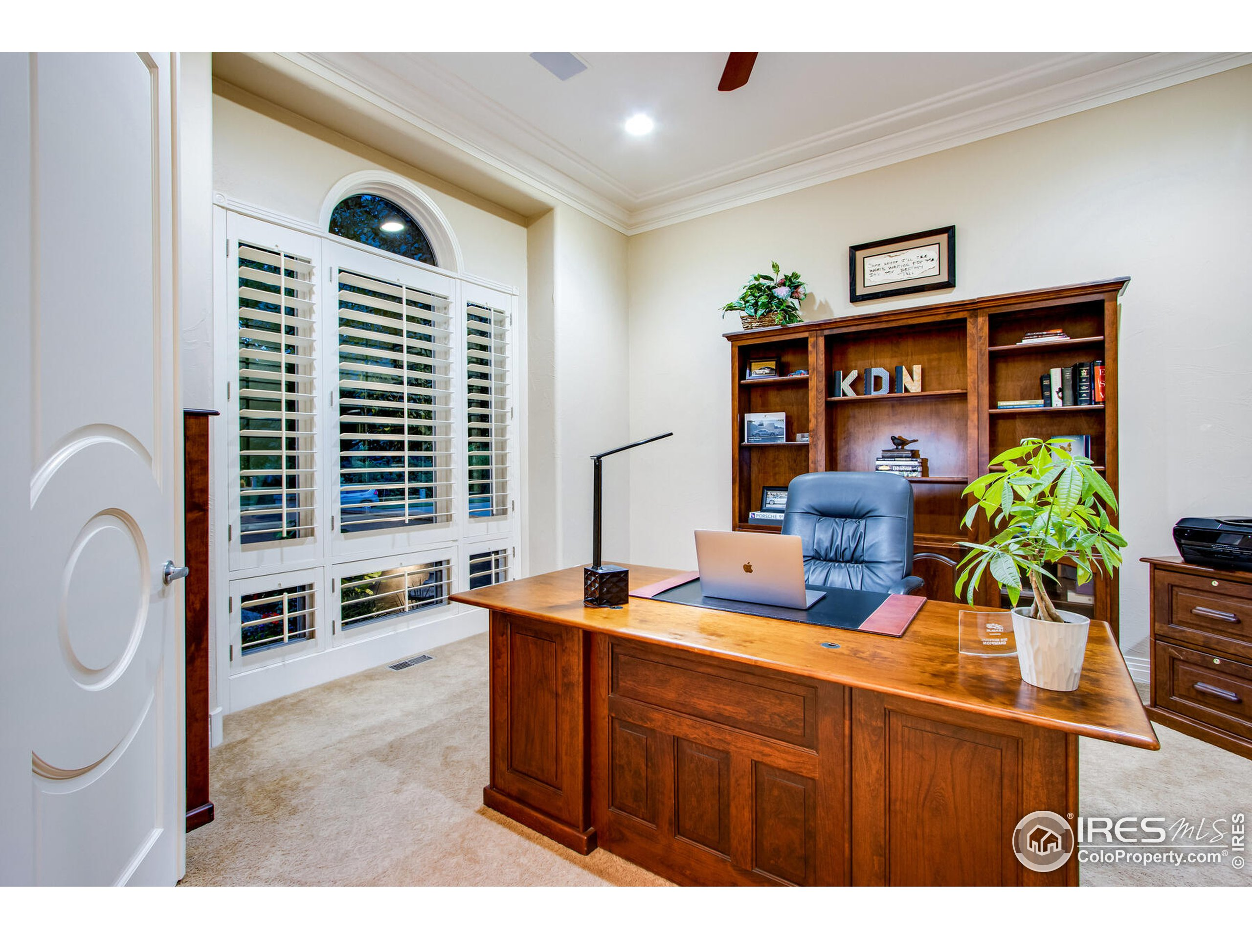 French Door Entry into the Main Floor Study with crown molding & overlooking the beautiful courtyard