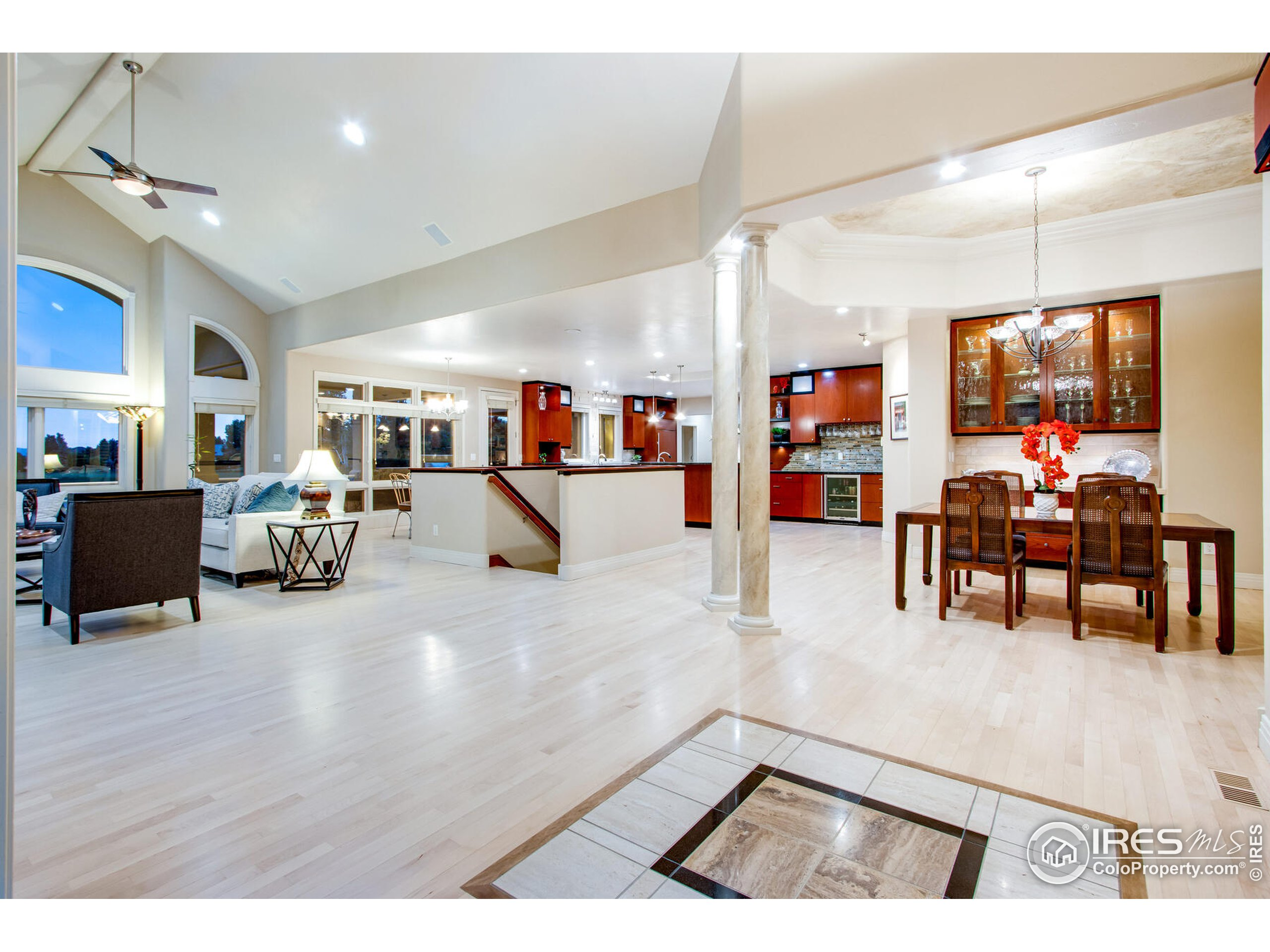 Unique Travertine Inlay Entry Design with High End Maple floors throughout