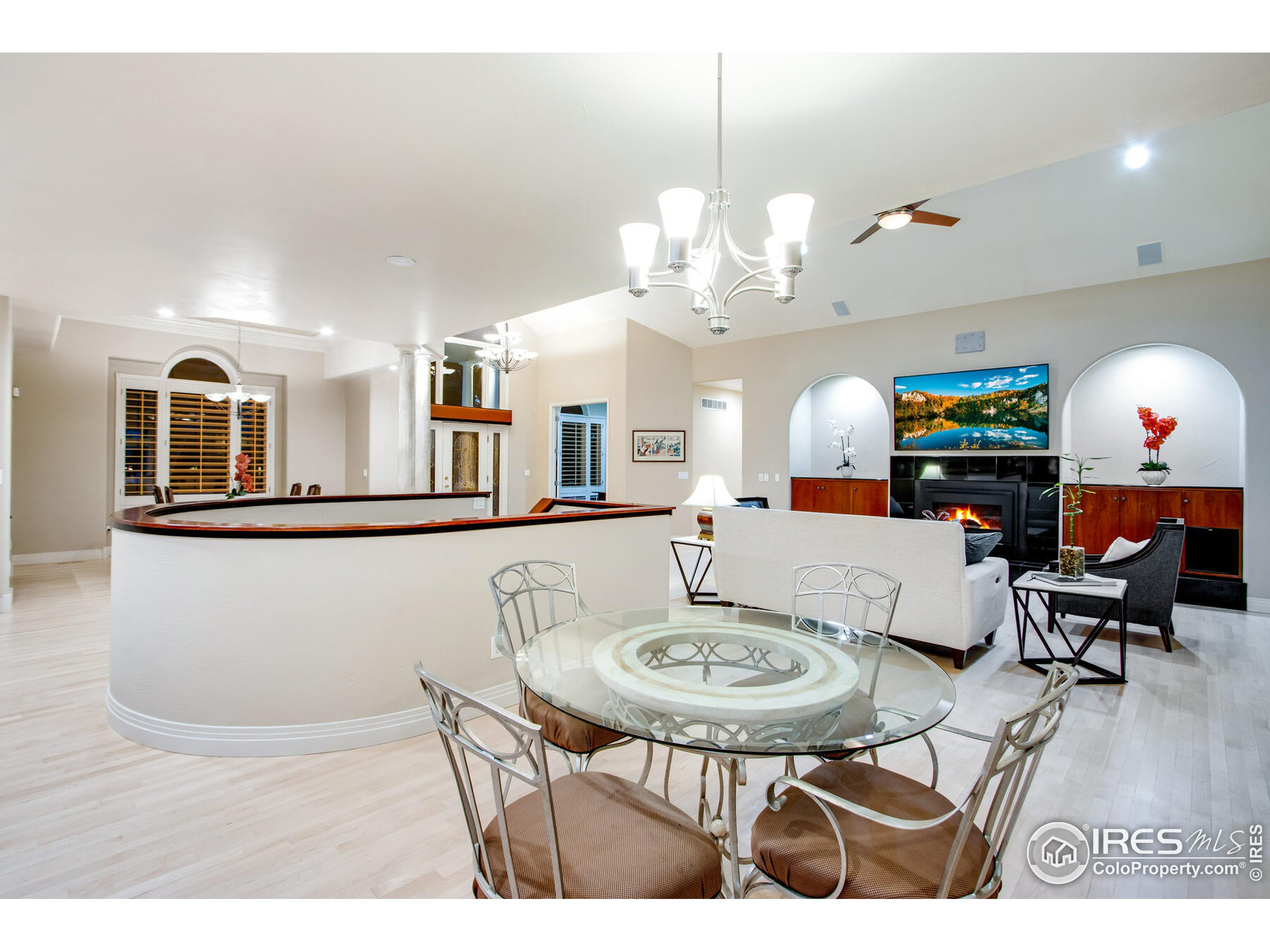 Breakfast Nook view into great room with contemporary granite, glass rock gas fireplace with surround sound throughout