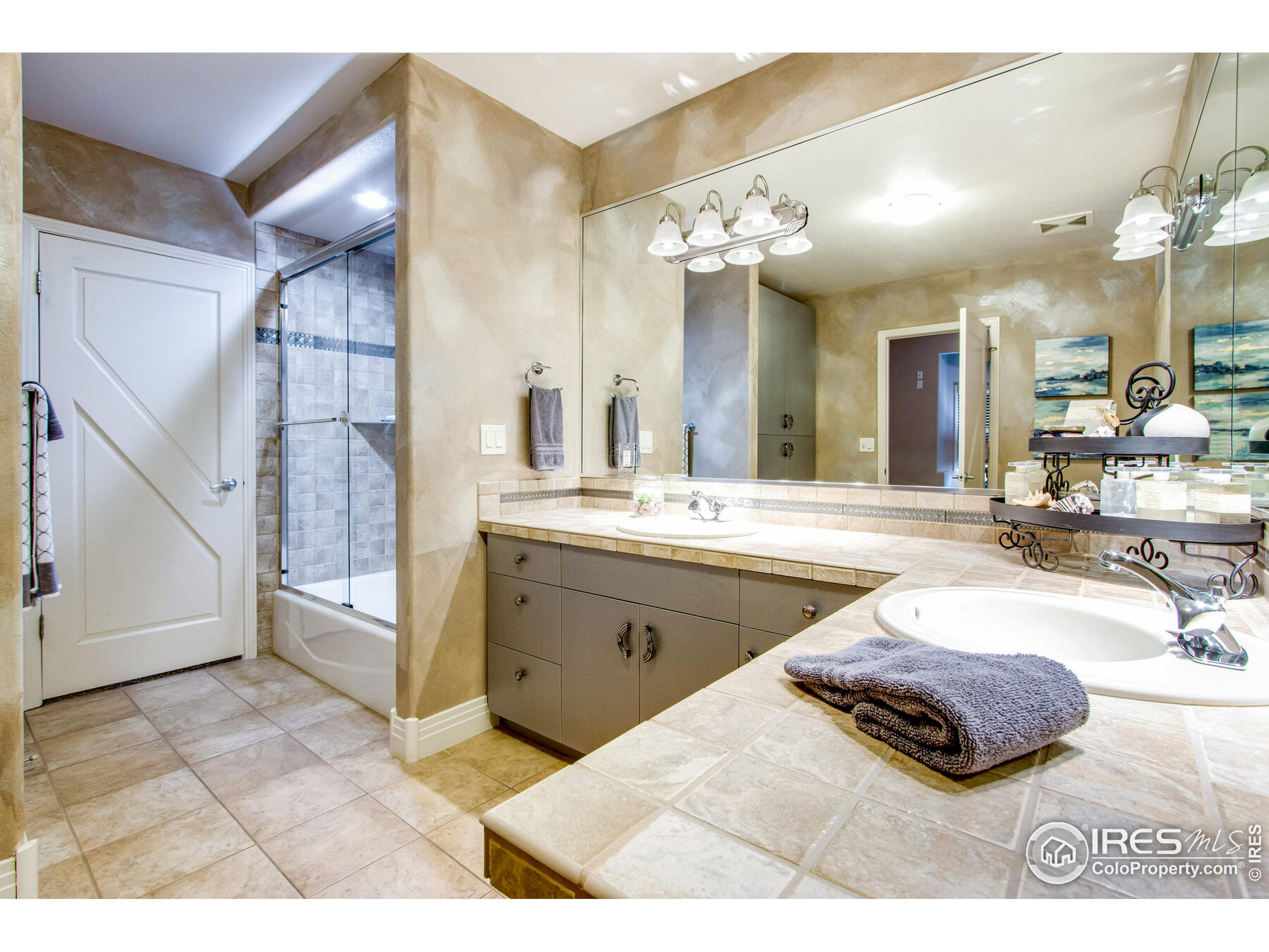 Lower Level Jack & Jill Bath with rare cast iron tub & shower with exceptional finishes