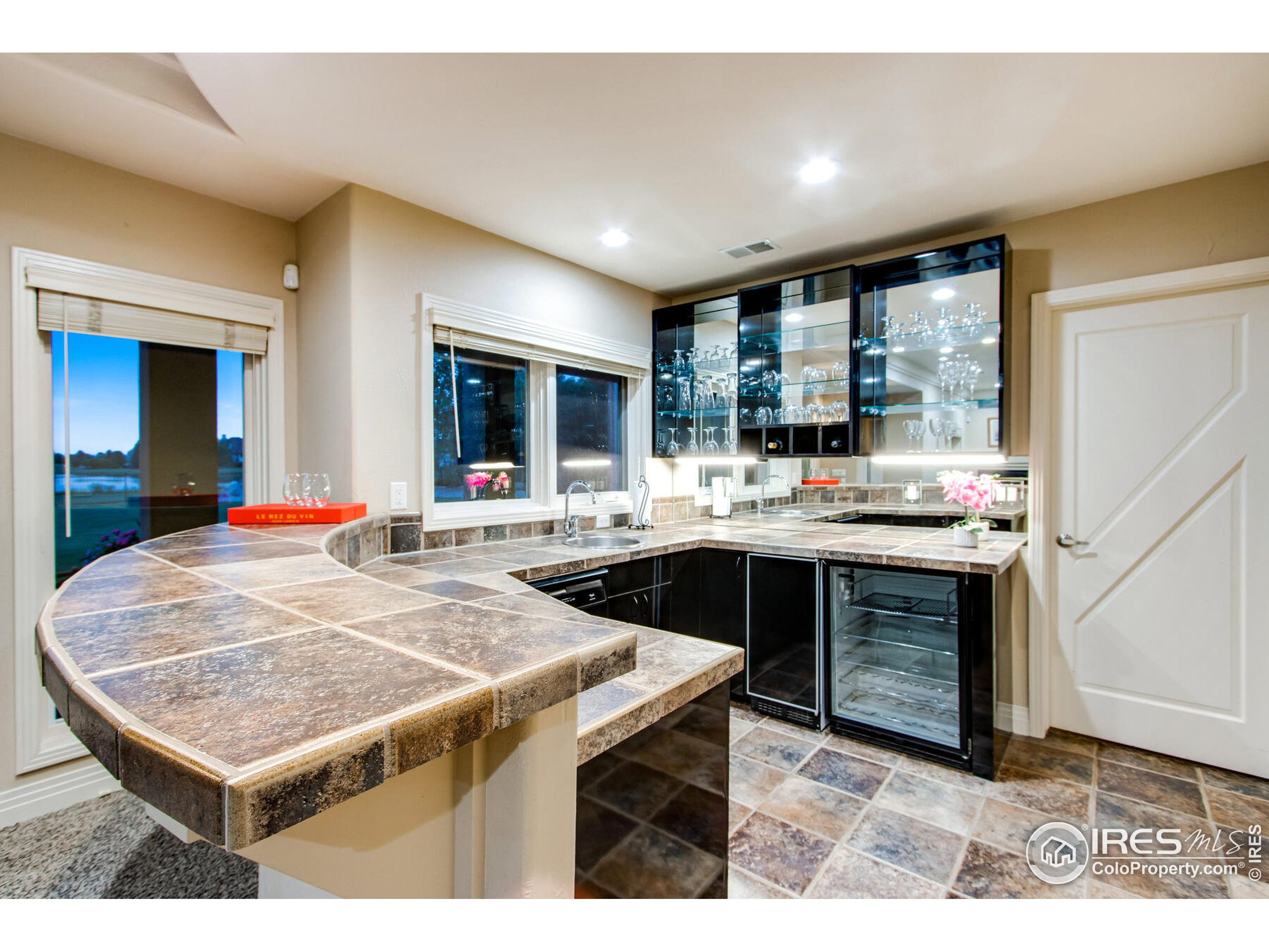Lower Level Kitchenette with sink, Scotsman Ice Maker, Marvel Beverage Frig, dishwasher & more for hosting large gatherings, or relaxing family movie nights