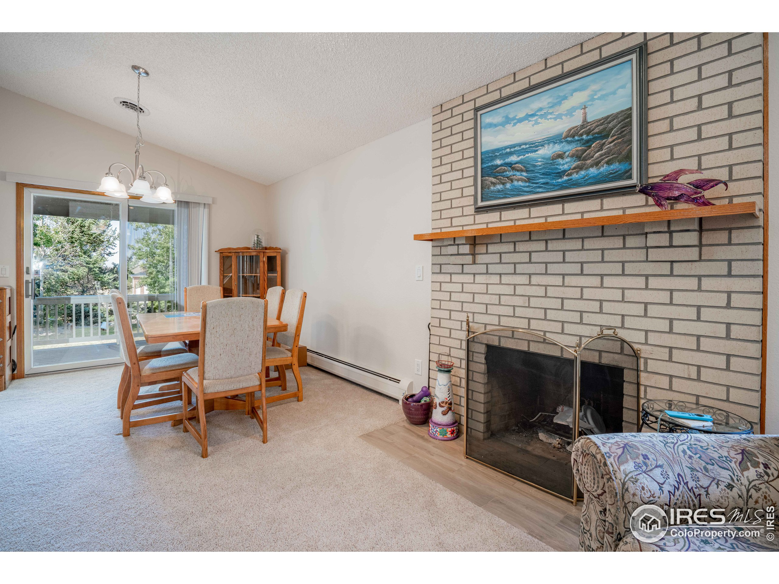 Cozy Gas Fireplace shared by Living, Dining Rooms