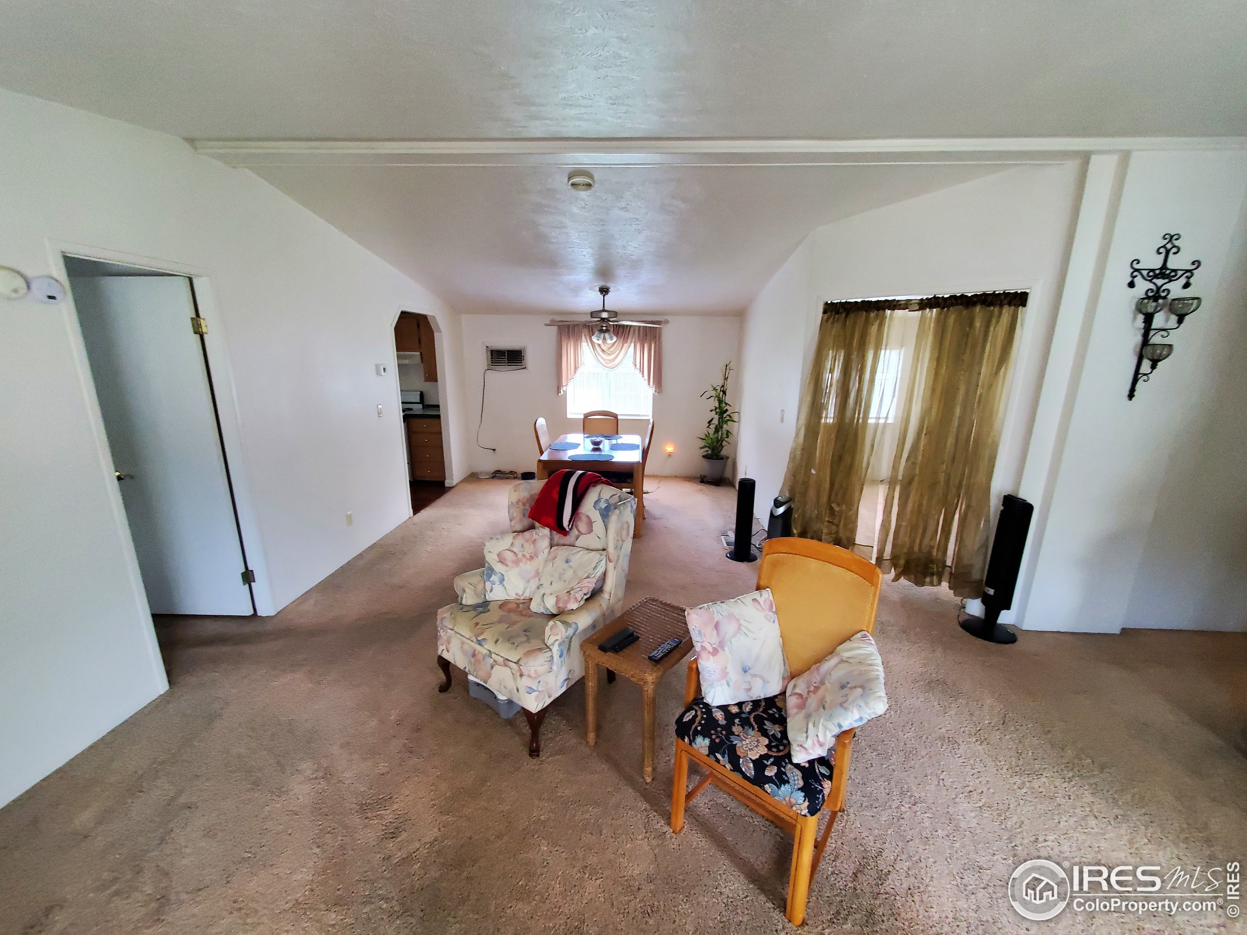 Large Living room leads to dining area & Den (behind curtain)