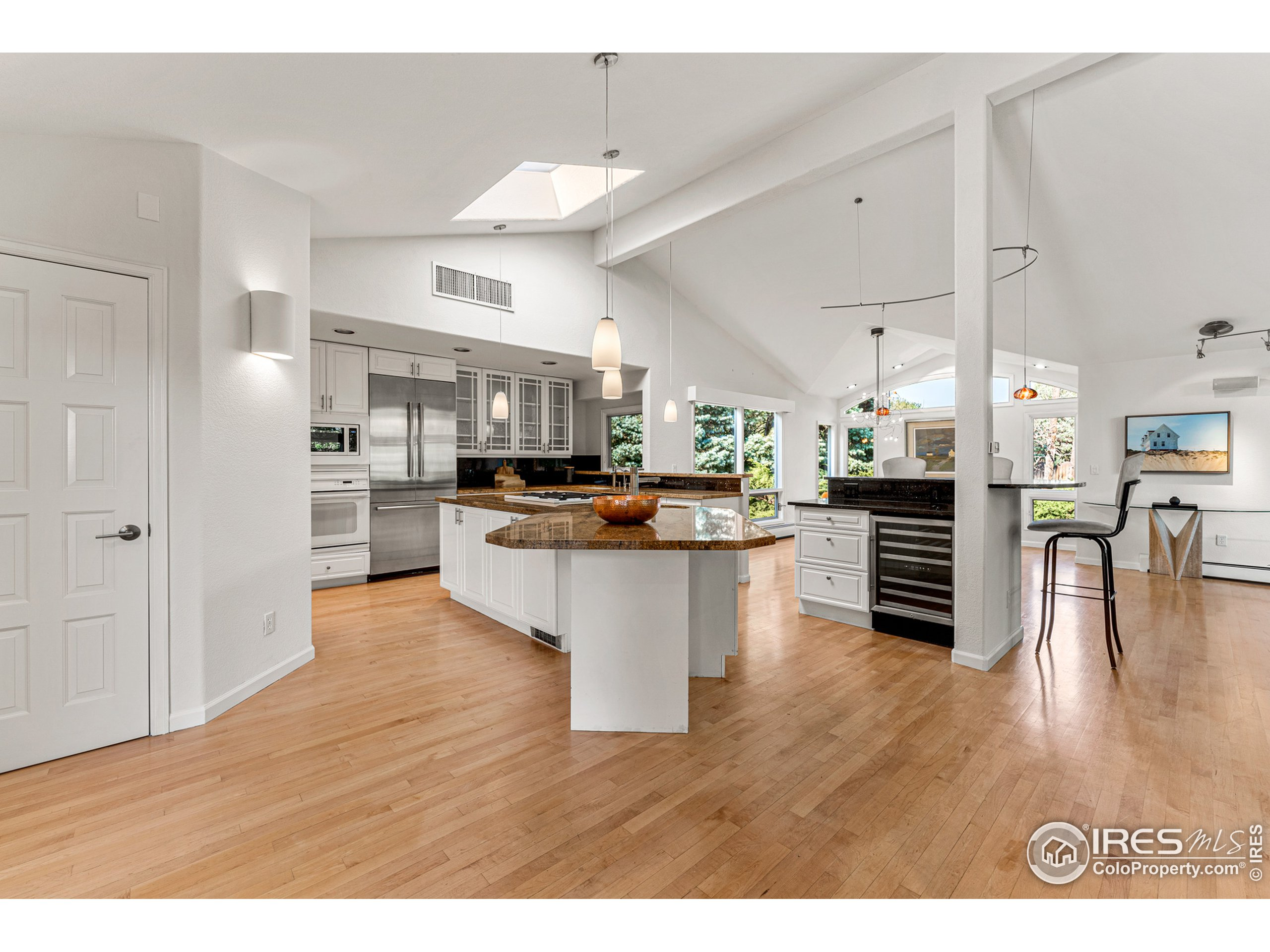 Grantie counters, prep sink, Bosch refrigerator + wine refrigerator, pantry and coutertop seating.