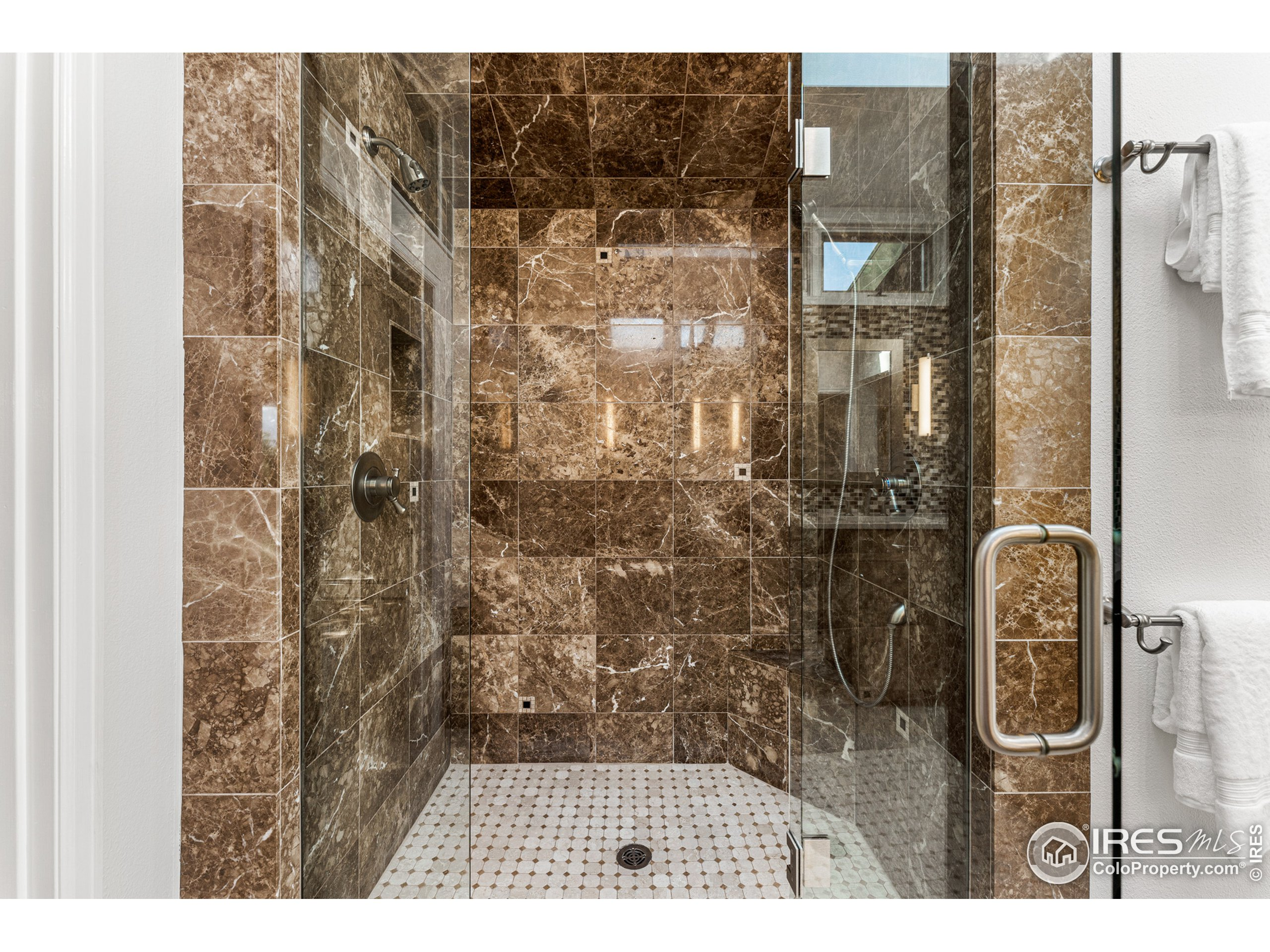 Primary Suite shower with dual heads