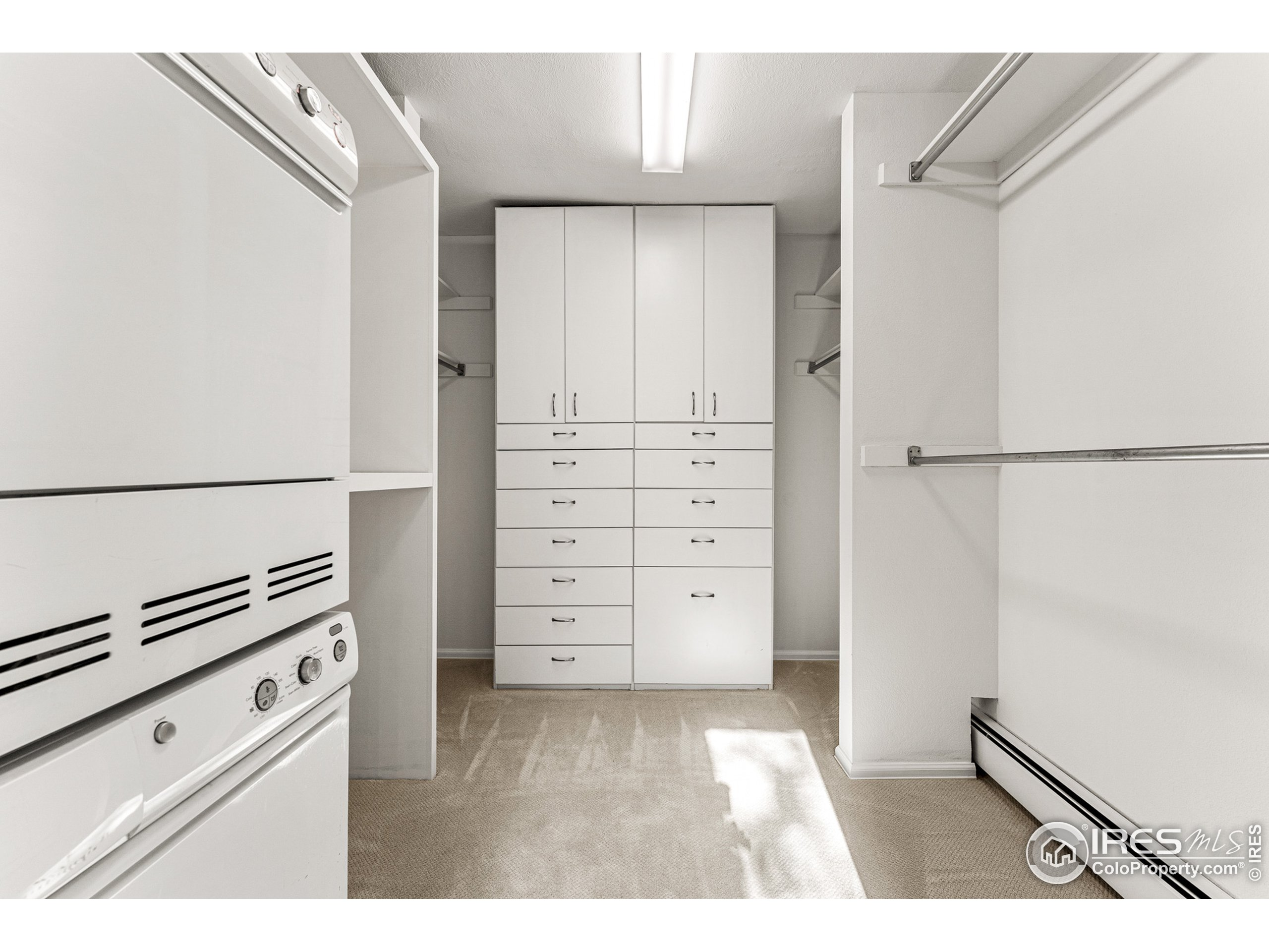 Primary Suite walk-in closet with built-in drawers. Includes an additonal Asko washer/dryer (main washer and dryer located on lower level)