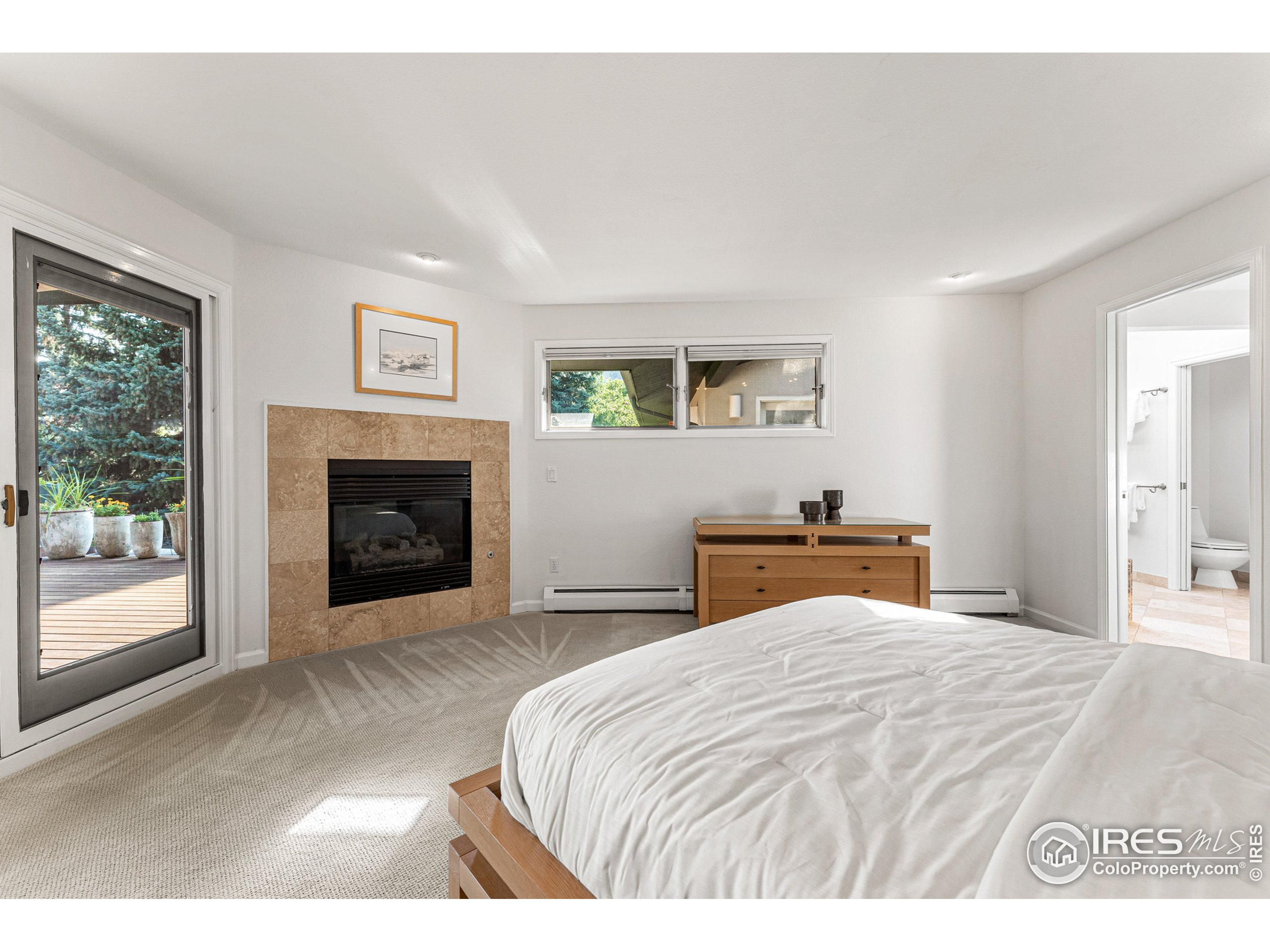 Primary suite with corner gas fireplace and mountain views