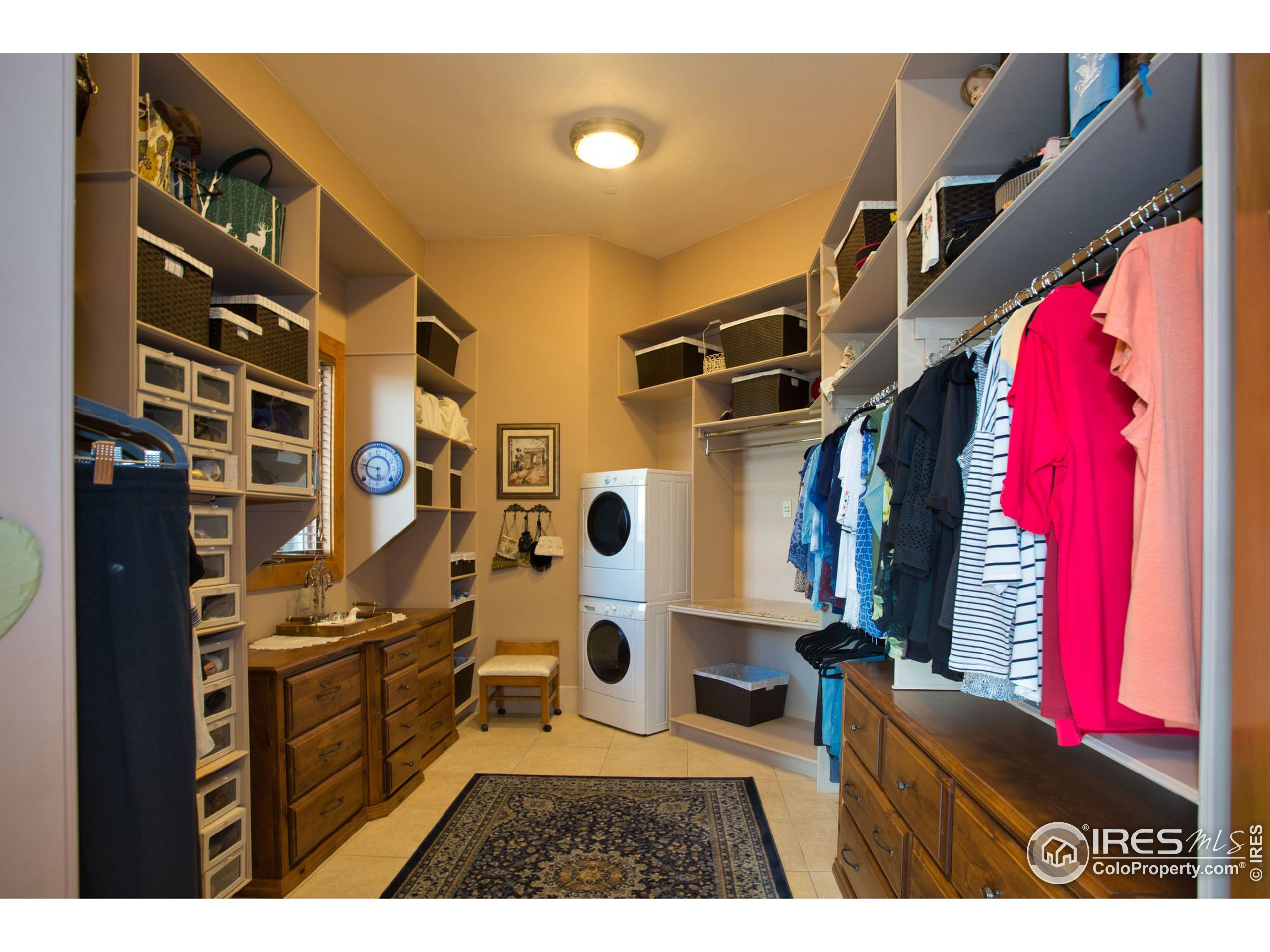 One of 2 master closets with 2nd laundry