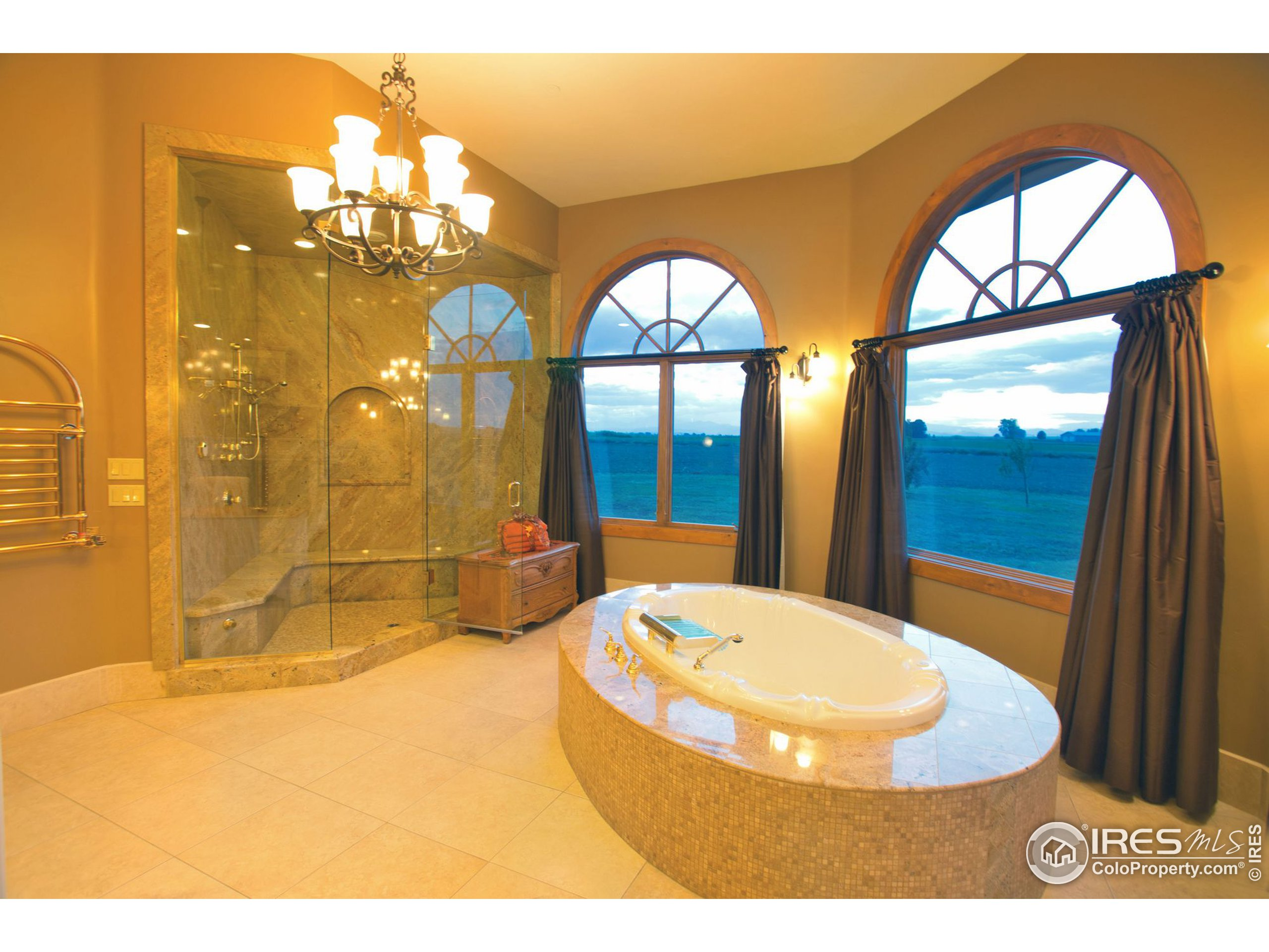 Master, jetted tub and large steam shower