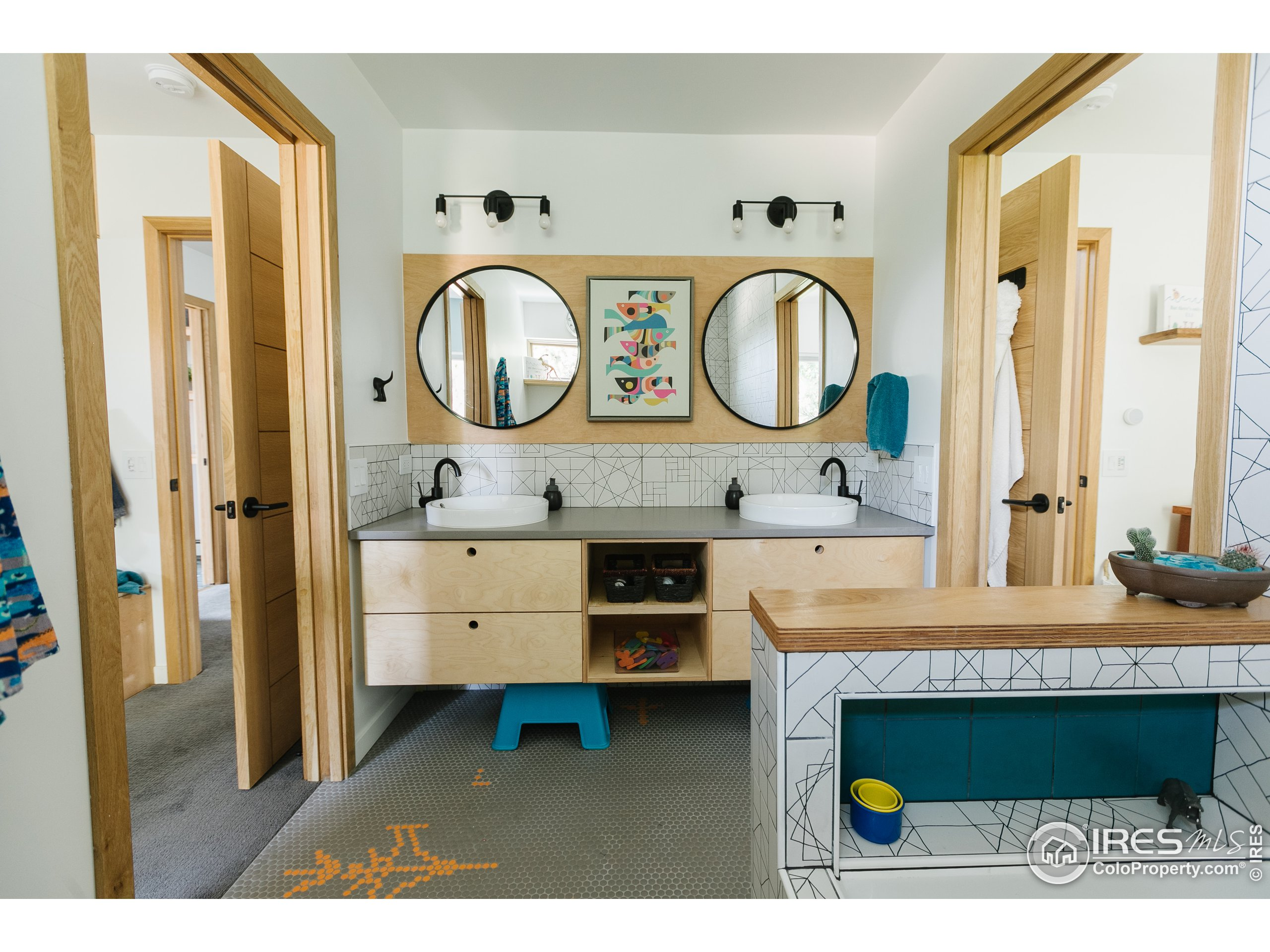 Jack and Jill bath with floor tile that will take you back to Defender and Space Invaders in nothing flat.