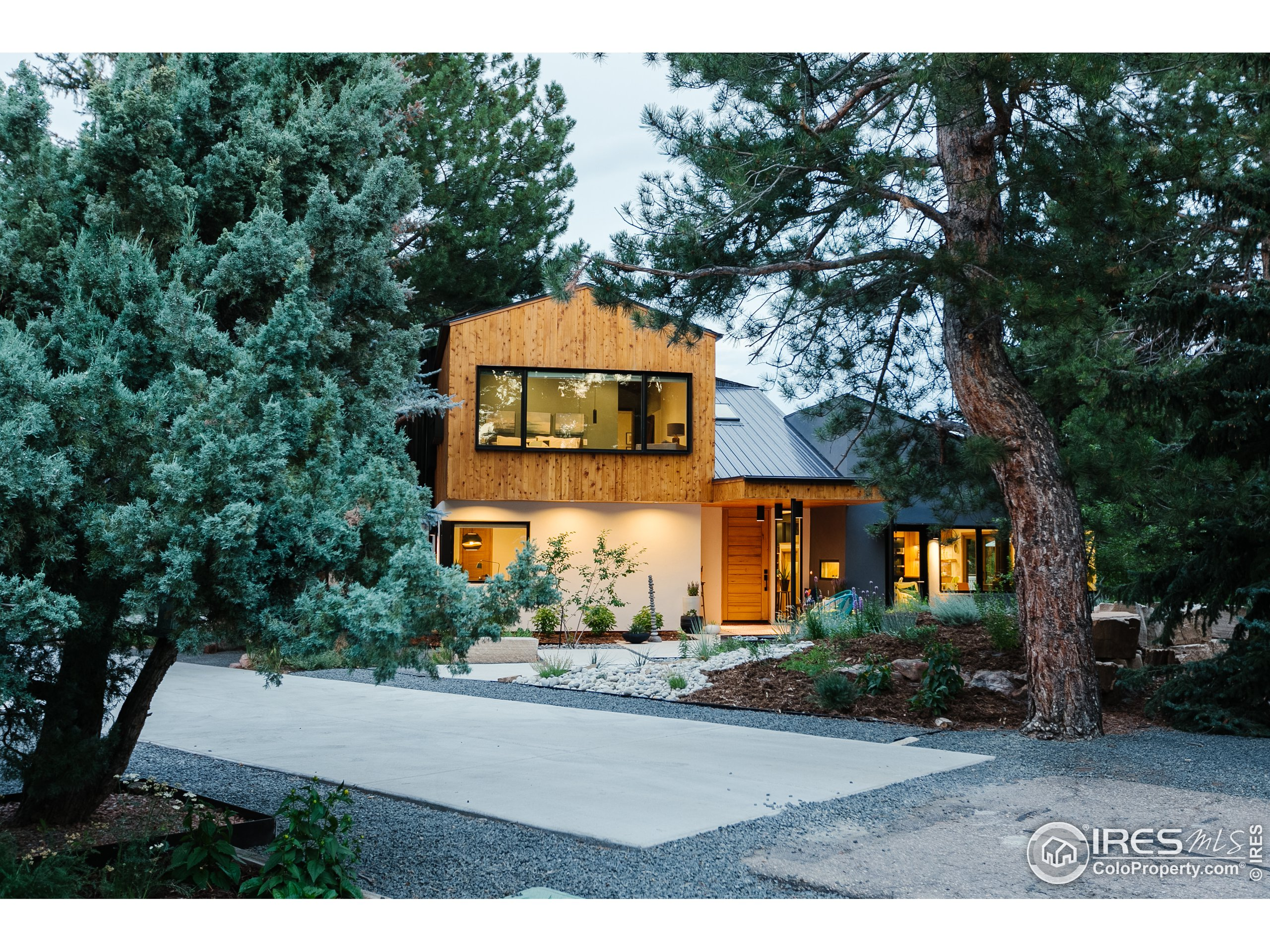 Modern masterpiece nestled in an oasis of old growth pines and centrally located in Fort Collins.