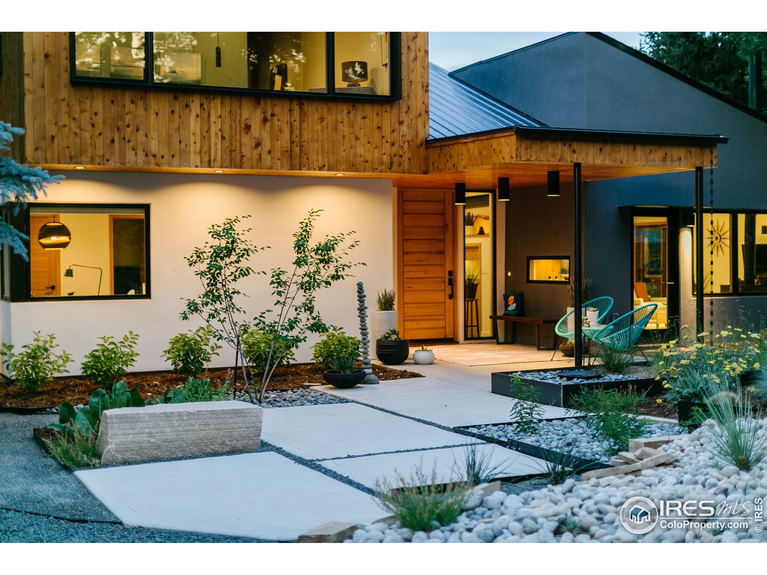 Custom Modern design greets you to this one of a kind Fort Collins home.
