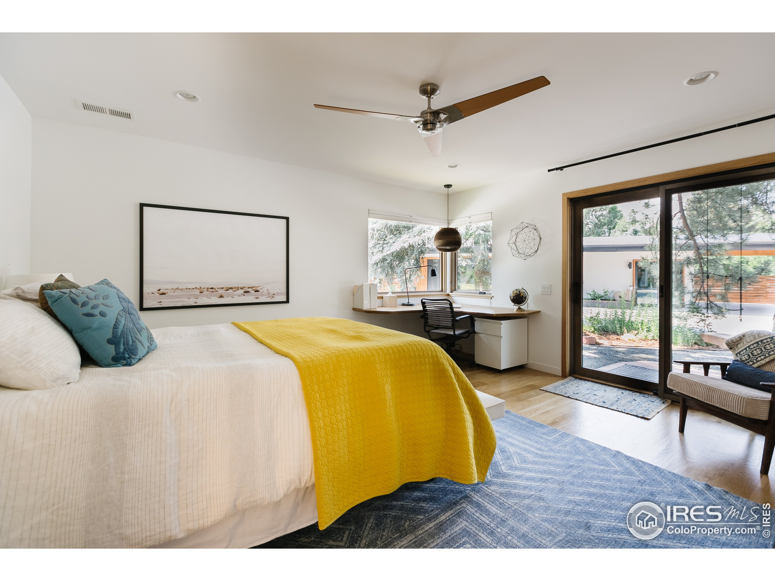 Main level bedroom is a second master suite.