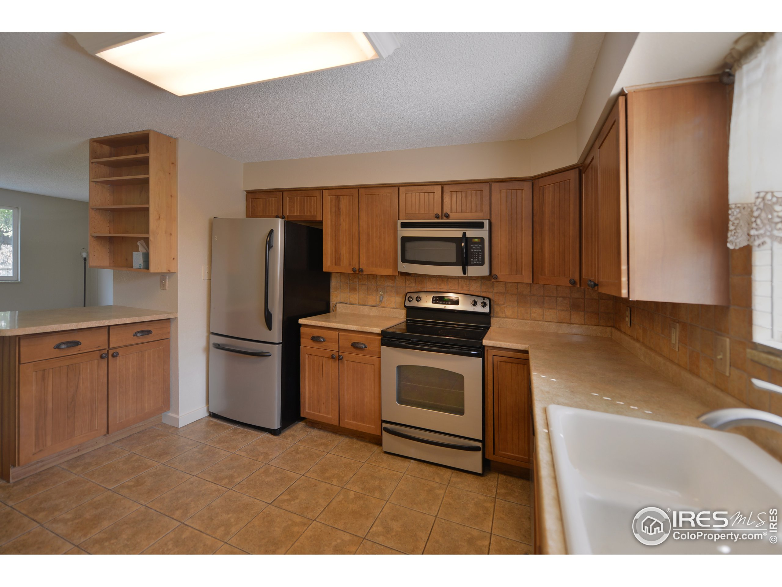Fully updated too with tile flooring and new cabinetry.