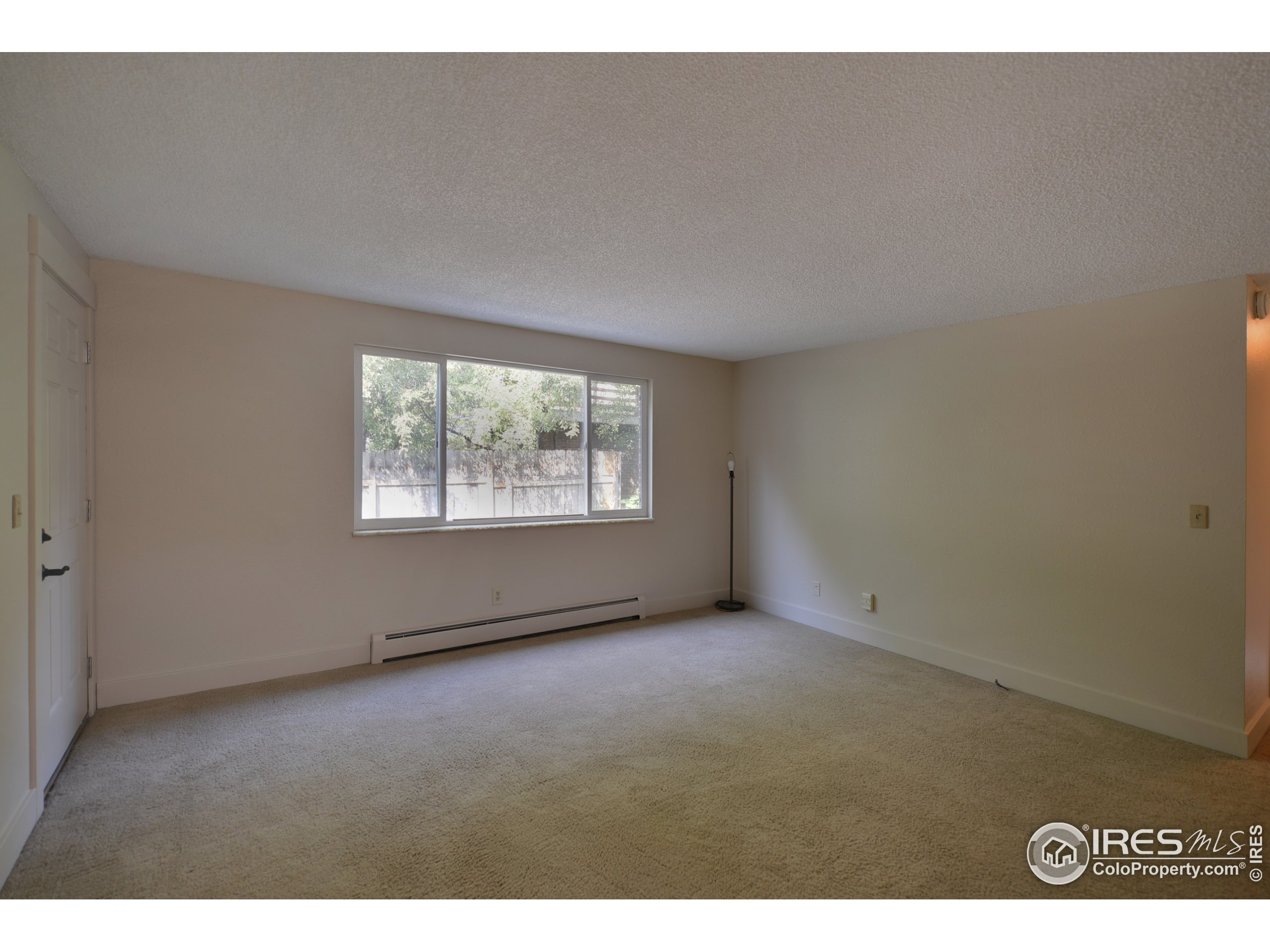 Large window and lots of wall space in the living room