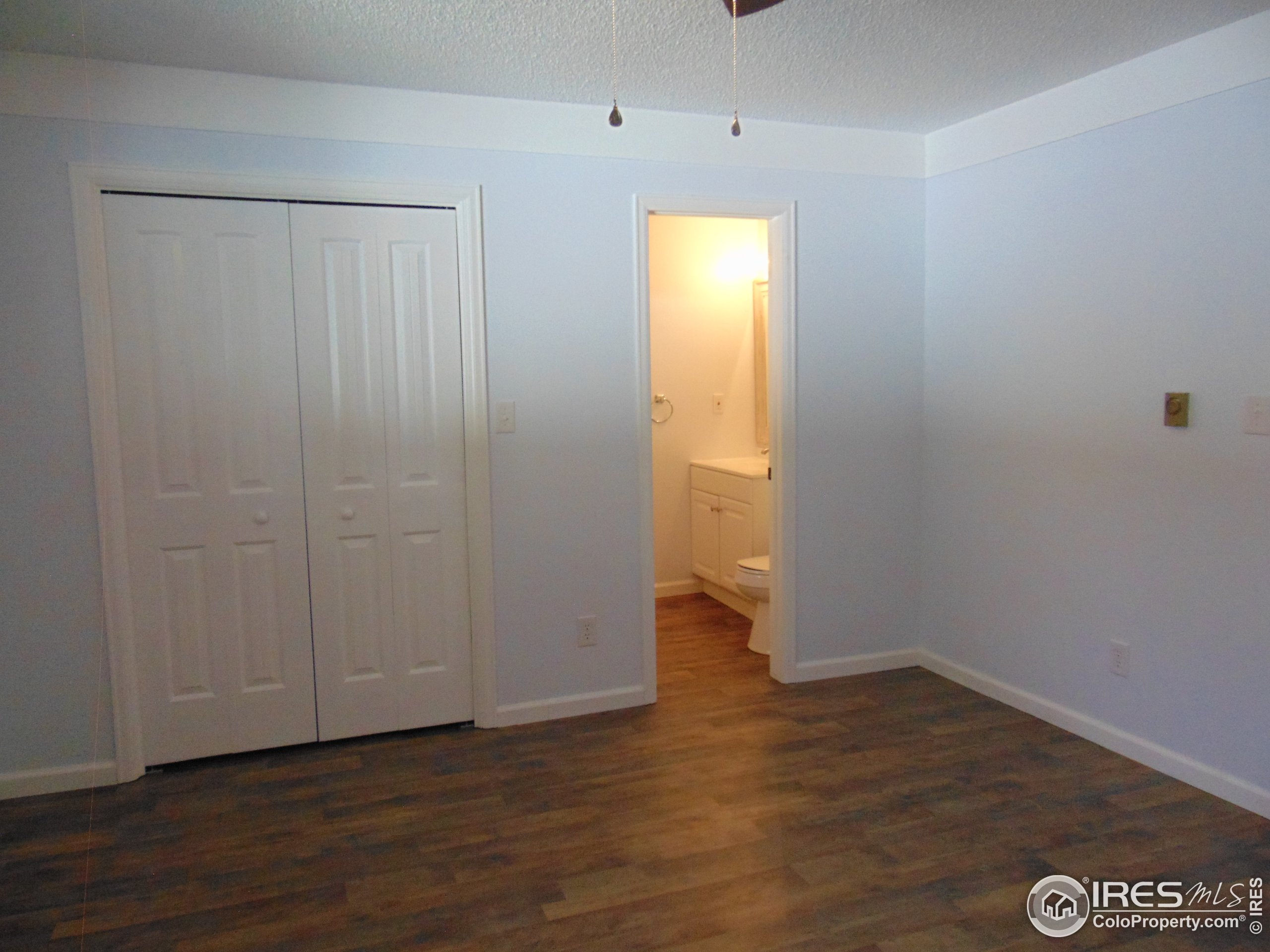 Primary Bedroom with a large closet and private 1/2 bath.