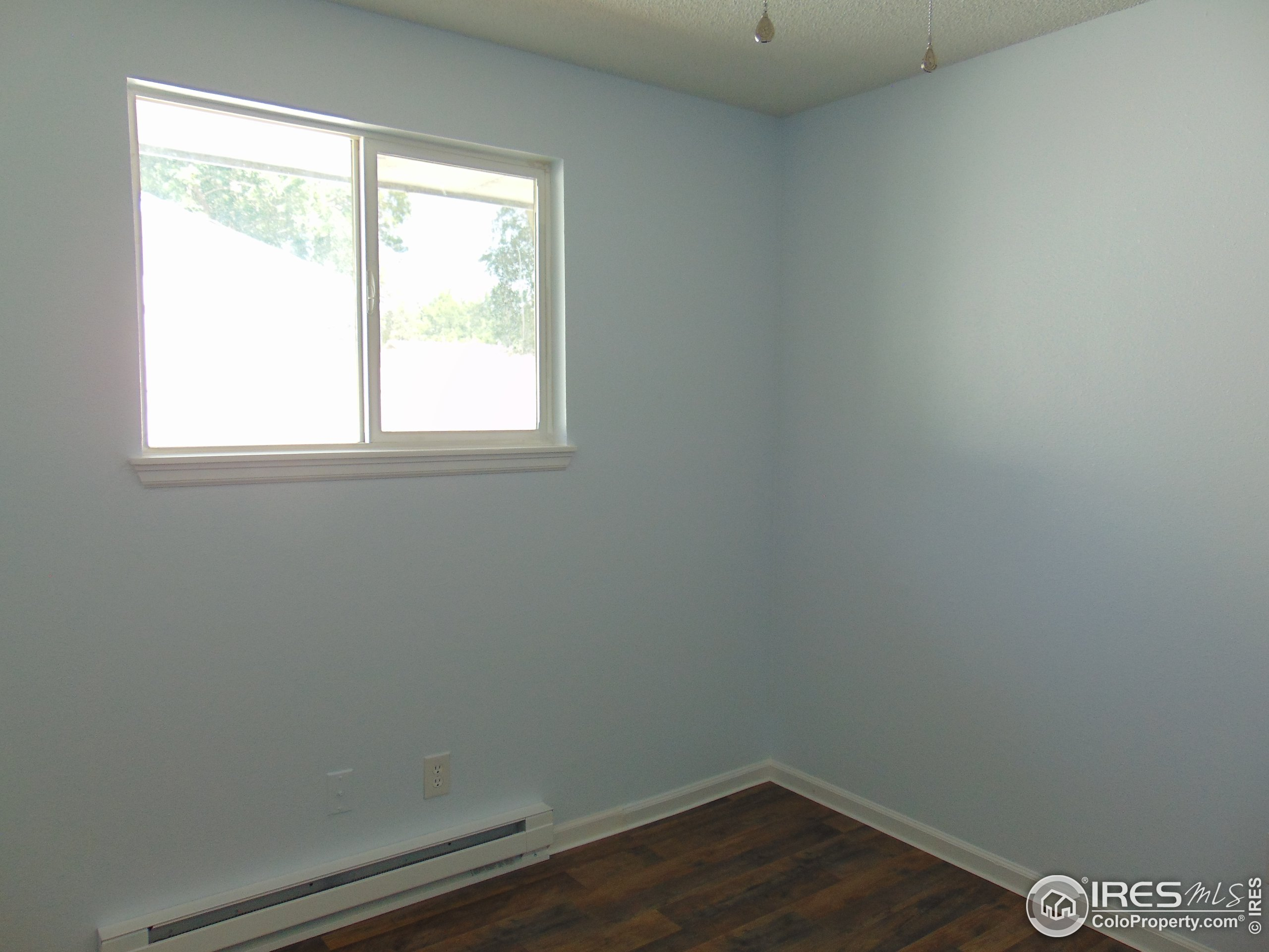 Second bedroom has lots of light with ceiling fan and new enviro friendly heating system
