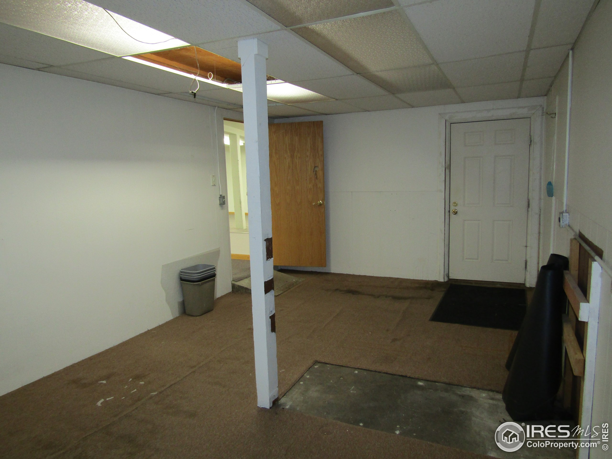 Other end of office 3. Exterior door to right is NW corner of building. Door at left goes into large open room
