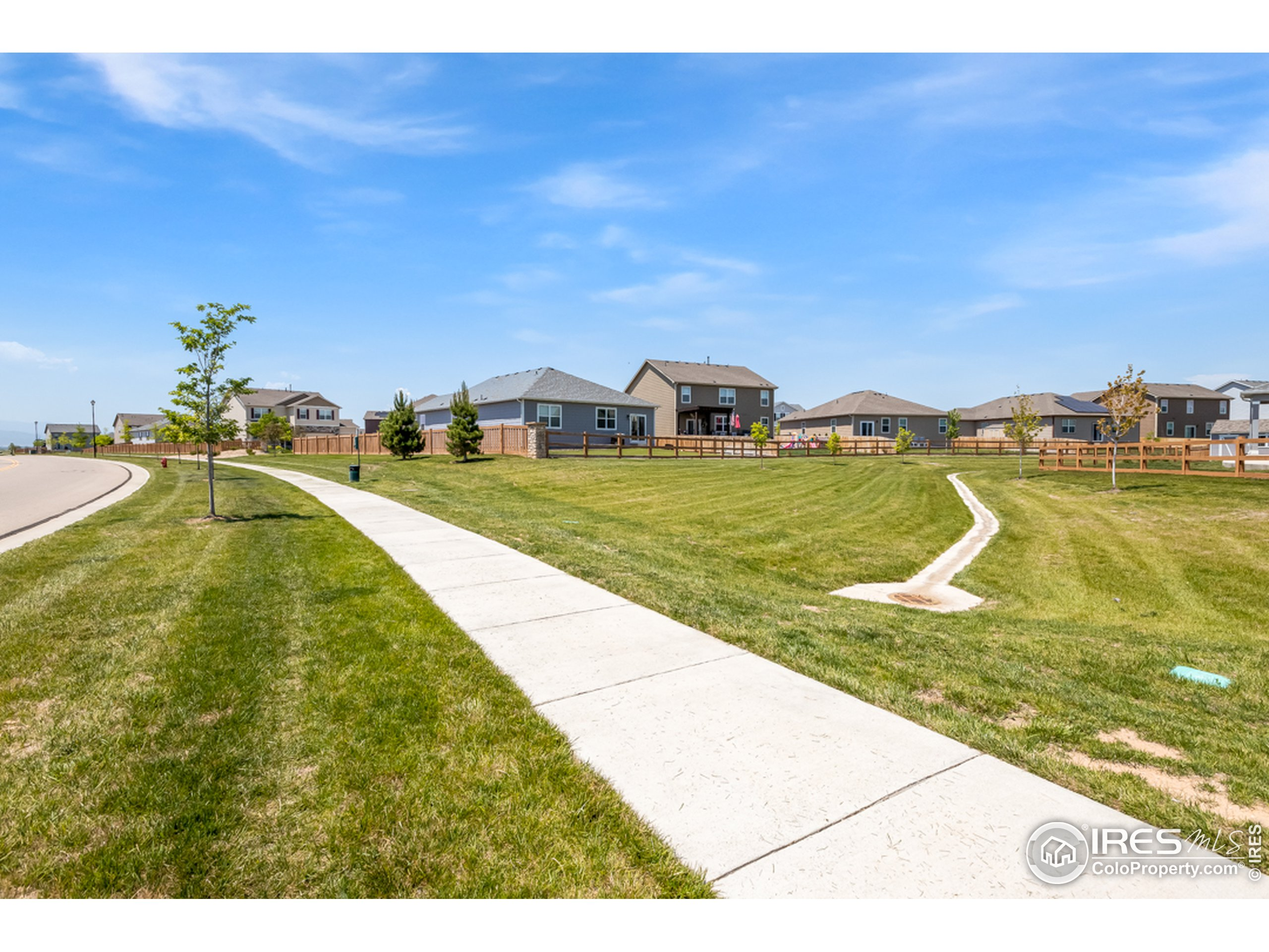 Extensive Neighborhood Green Space Behind Home allows for that Feeling of Roominess in a Neighborhood.