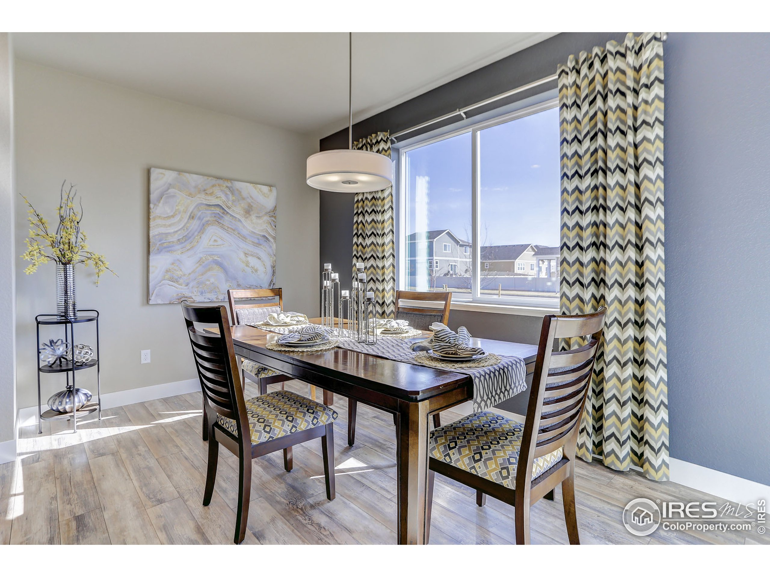 EXAMPLE PHOTO: DINING ROOM OFF OF THE KITCHEN WITH VINYL PLANK FLOORING