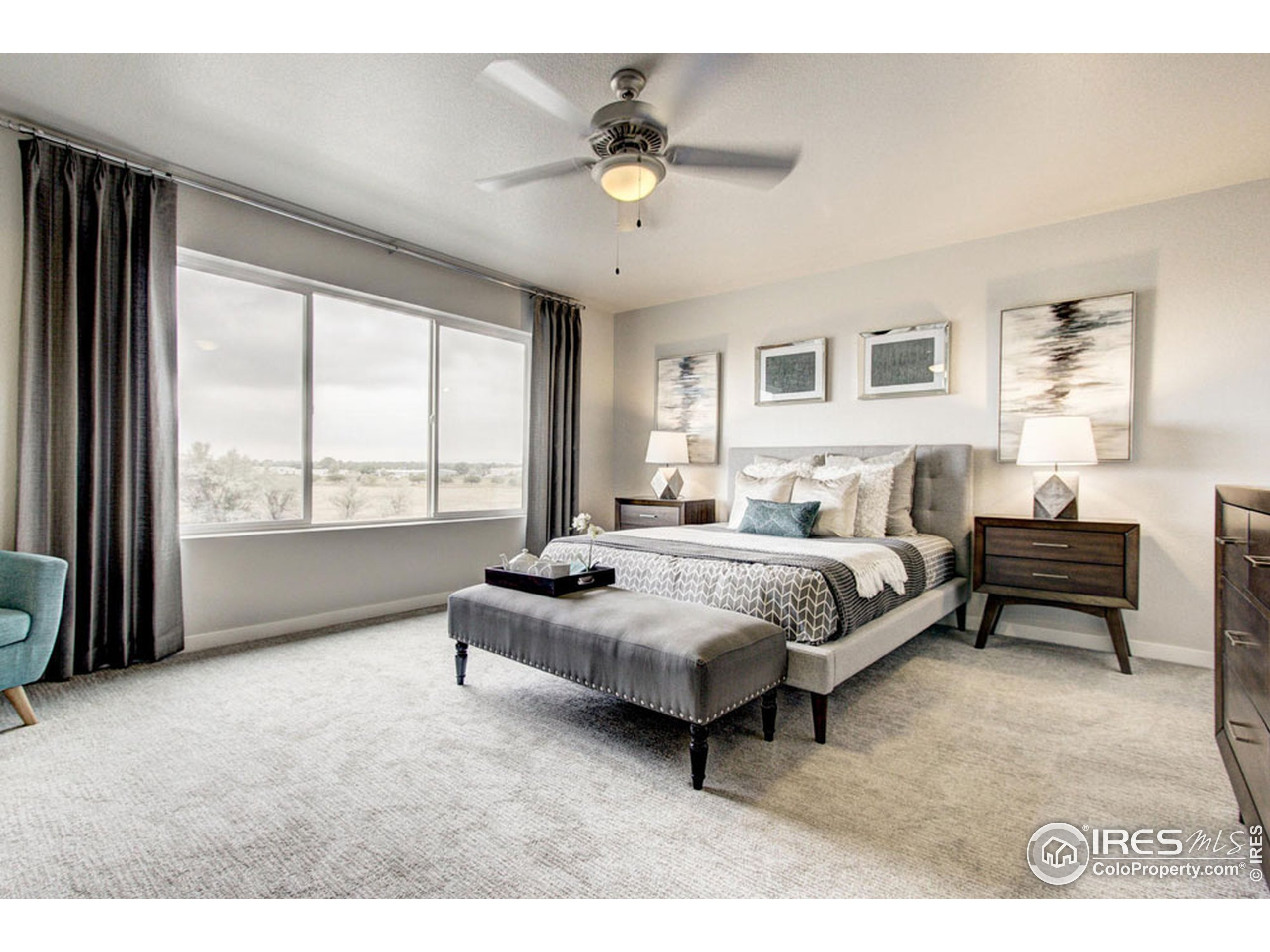 EXAMPLE PHOTO: MASTER BEDROOM ON SECOND LEVEL OF HOME WITH CARPET