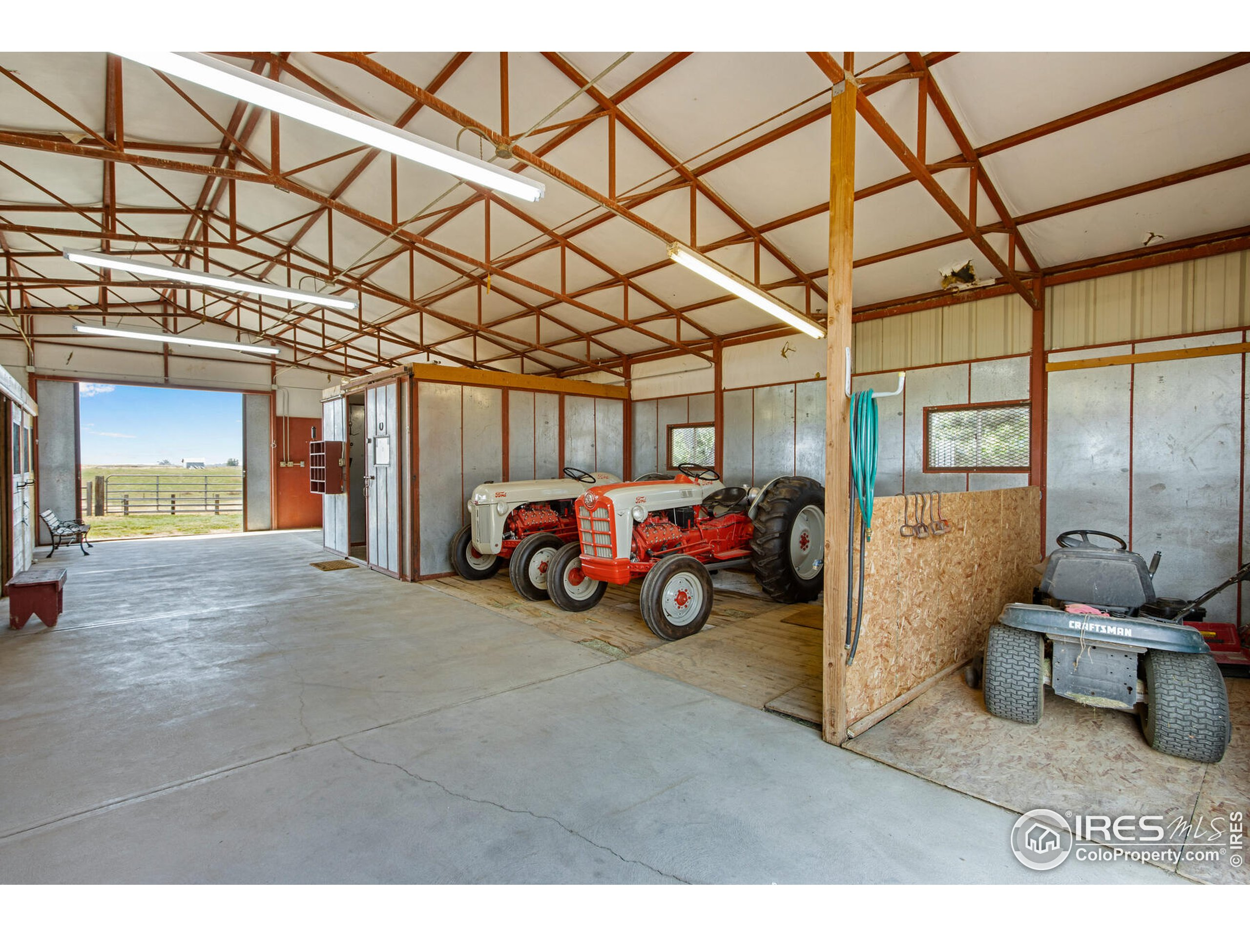 48 X 36 custom built metal/insulated 4 stall barn with overhang.  Tack room + cross tie area. Hay storage + shaving areas.
