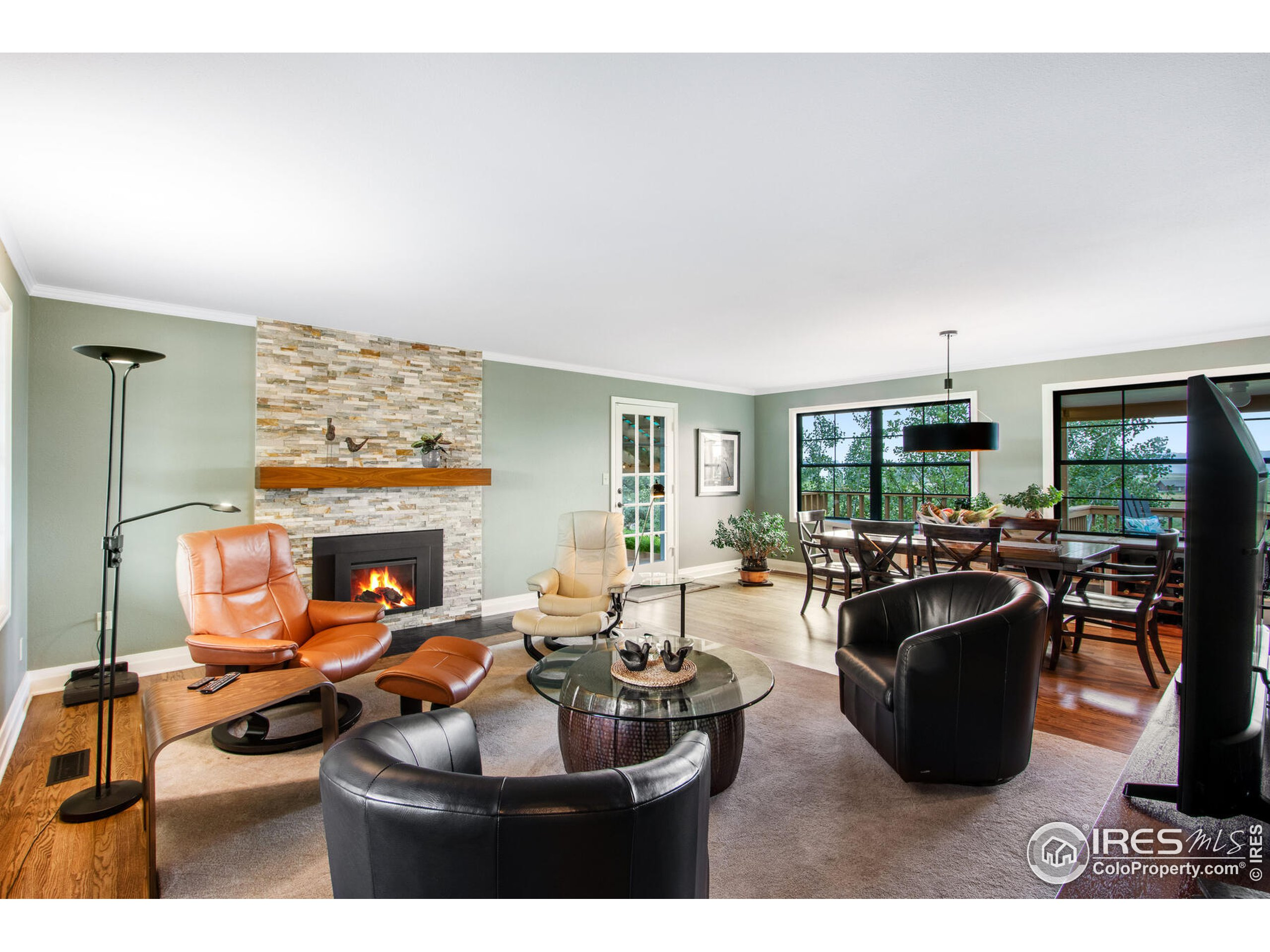 Stone Gas fireplace lights up the cozy main level living space, open concept layout.
