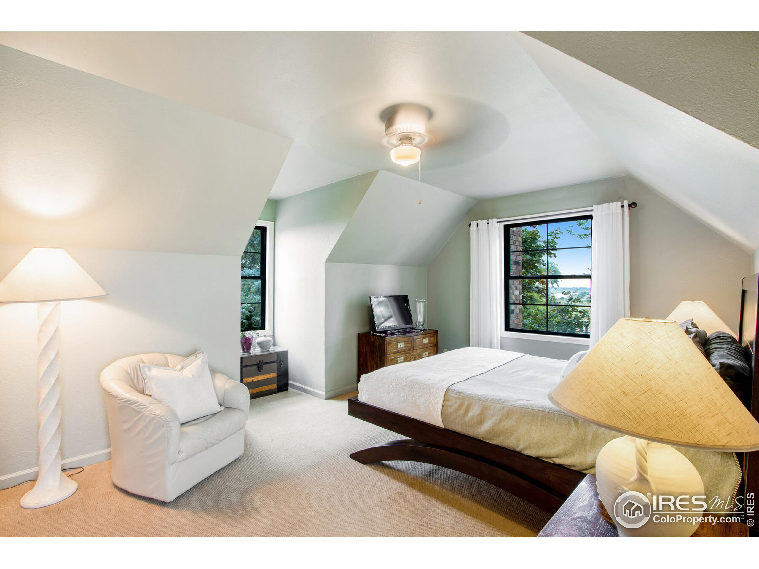 Bright and spacious upper left guest suite vaulted ceilings