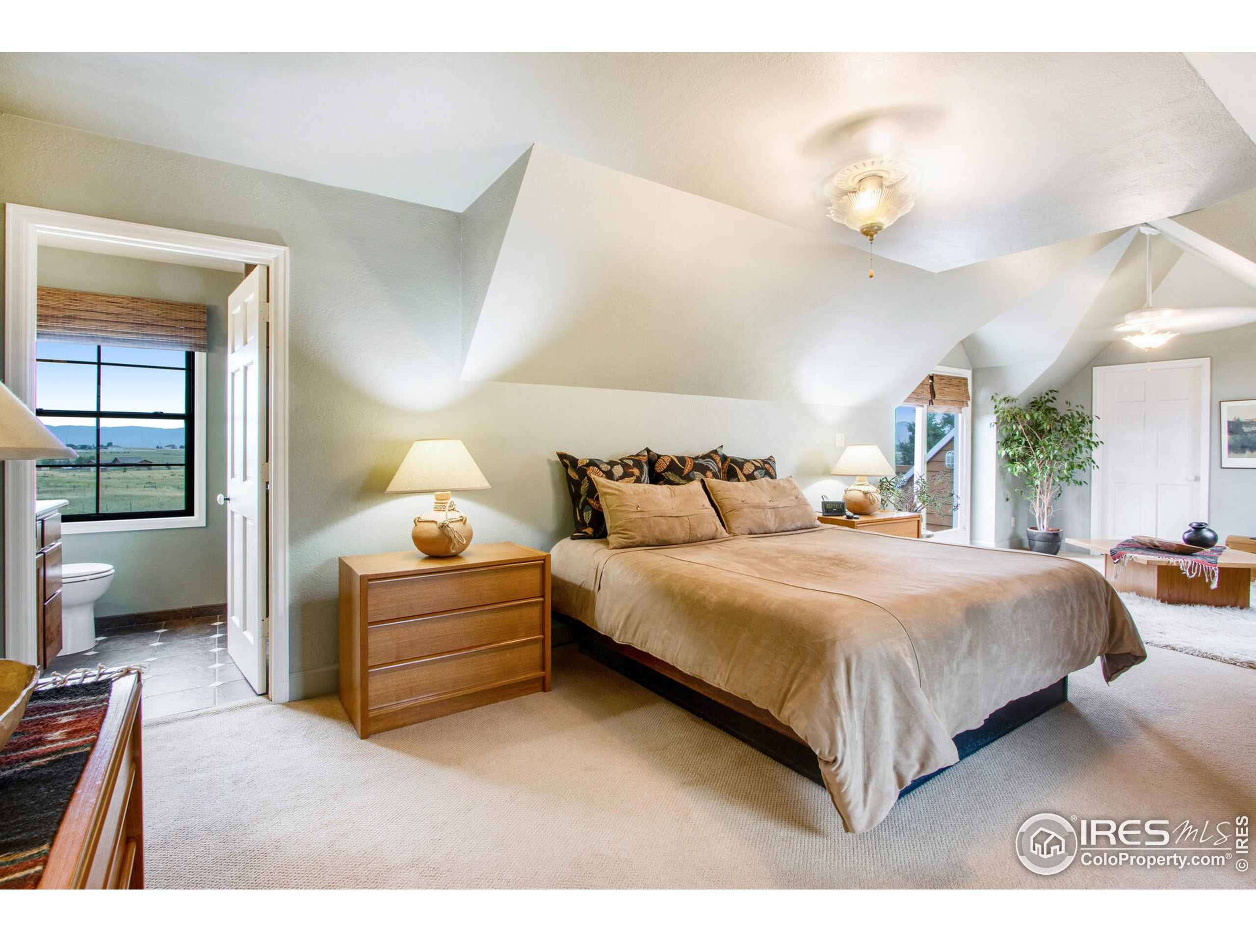 Another angle expansive Master Suite bright and spacious with stunning Rocky Mountain views!