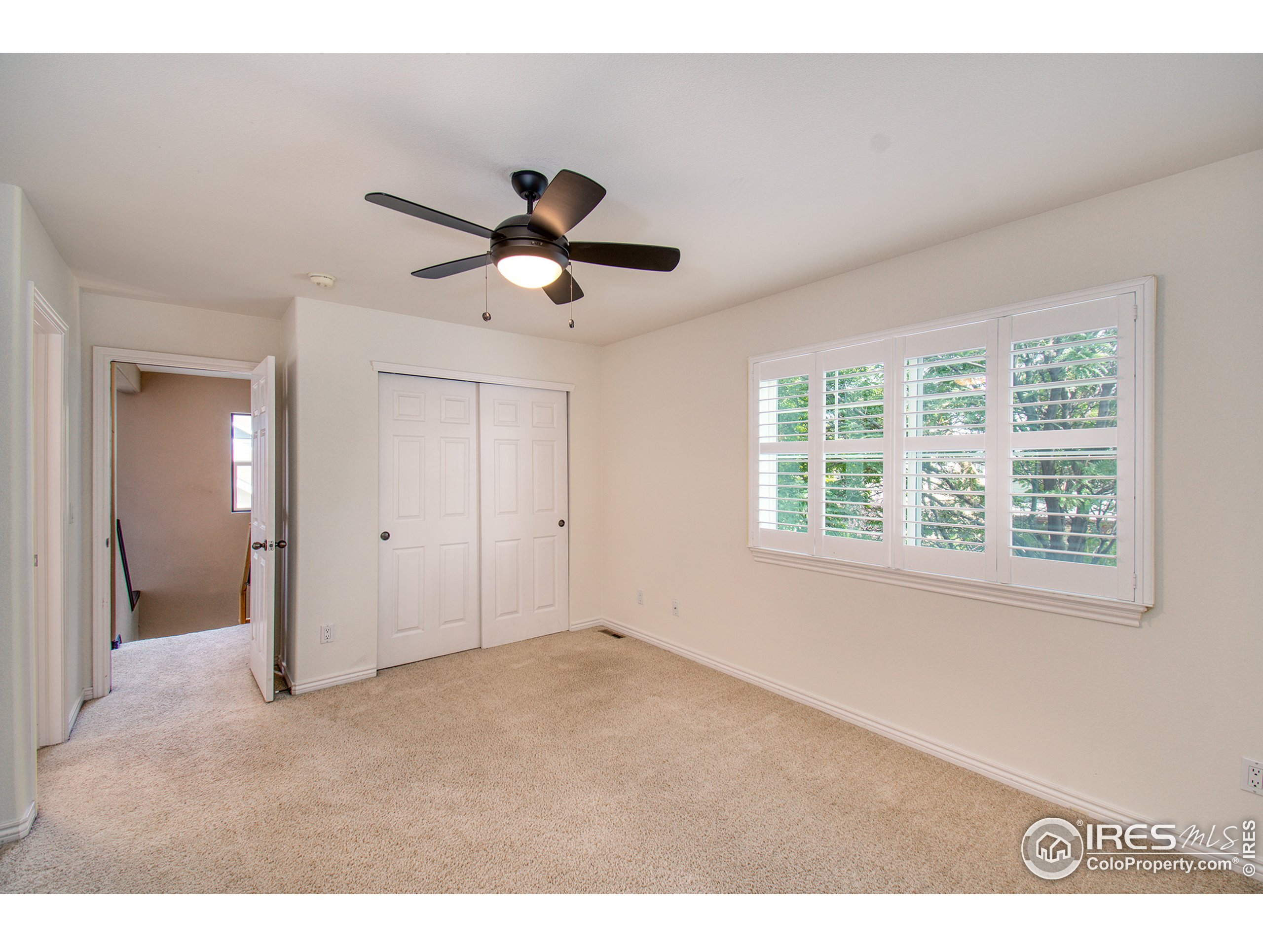 3rd bedroom with plantation shutters.