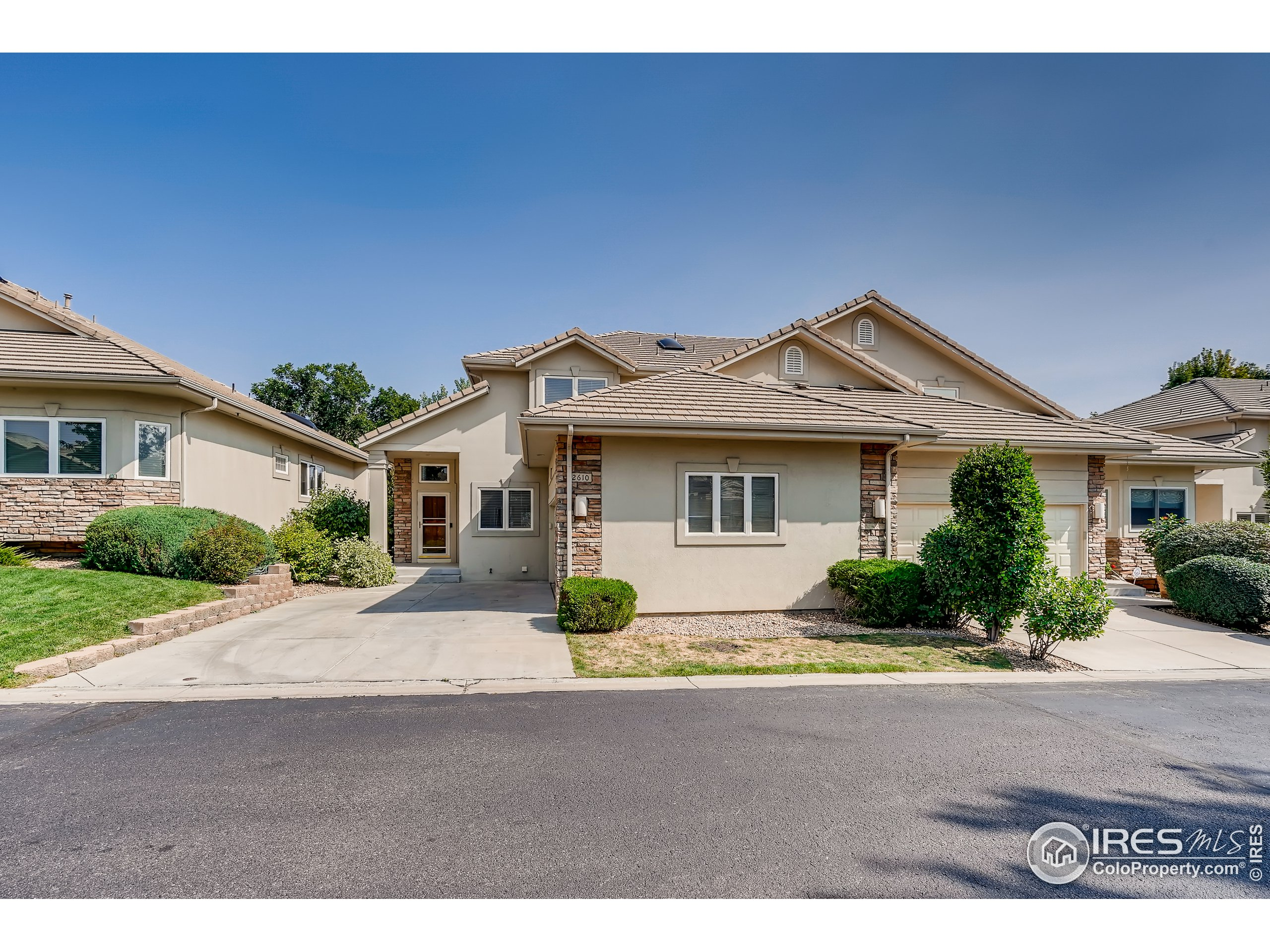 Fall in love with this stylish 4 bedroom, 3 bathroom home in a quiet, gated neighborhood in Lakewood. Upon entering you will immediately notice the gorgeous 2 story foyer and richly-appointed spaces. The main living area is an open concept layout with a warm, inviting living room that provides a stone covered gas fireplace to warm up on a cold winter night. The gourmet kitchen is outfitted with stainless steel appliances, granite countertops, a sleek backsplash, a breakfast bar, and a breakfast nook for entertaining. This home benefits from 2 primary bedrooms that include an en-suite bathroom complete with a soaking tub and a separate shower. The main floor primary bedroom offers direct access to the back deck and the upstairs primary bedroom features spacious closet space with an island and skylight. Additional highlights include a laundry room with overhead storage and an attached 2 car garage. Conveniently located near Red Rocks and much more.