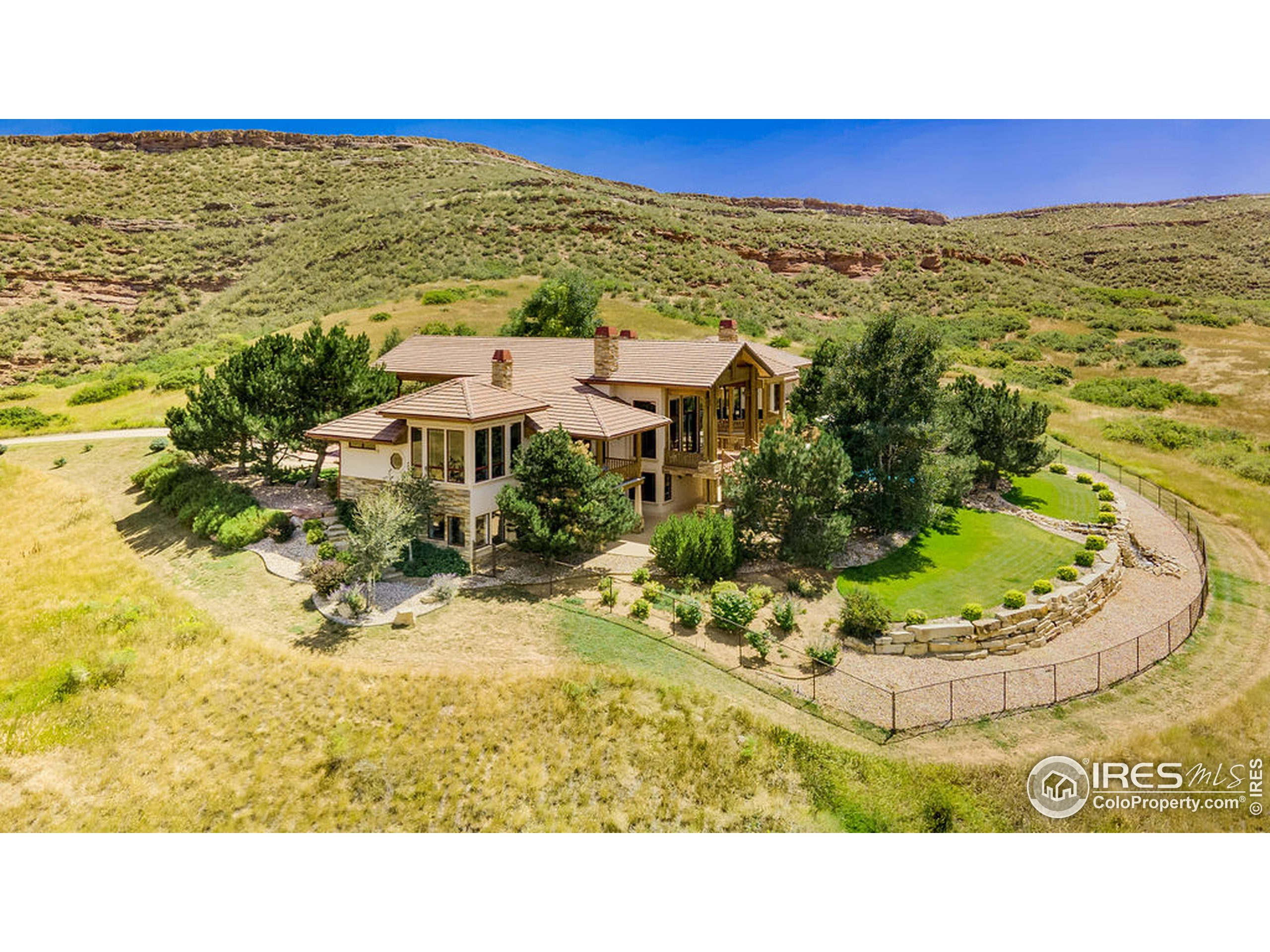 Aerial view, facing Indian Creek Rd. The north corner glass rooms are the Master & Guest Suite Baths.