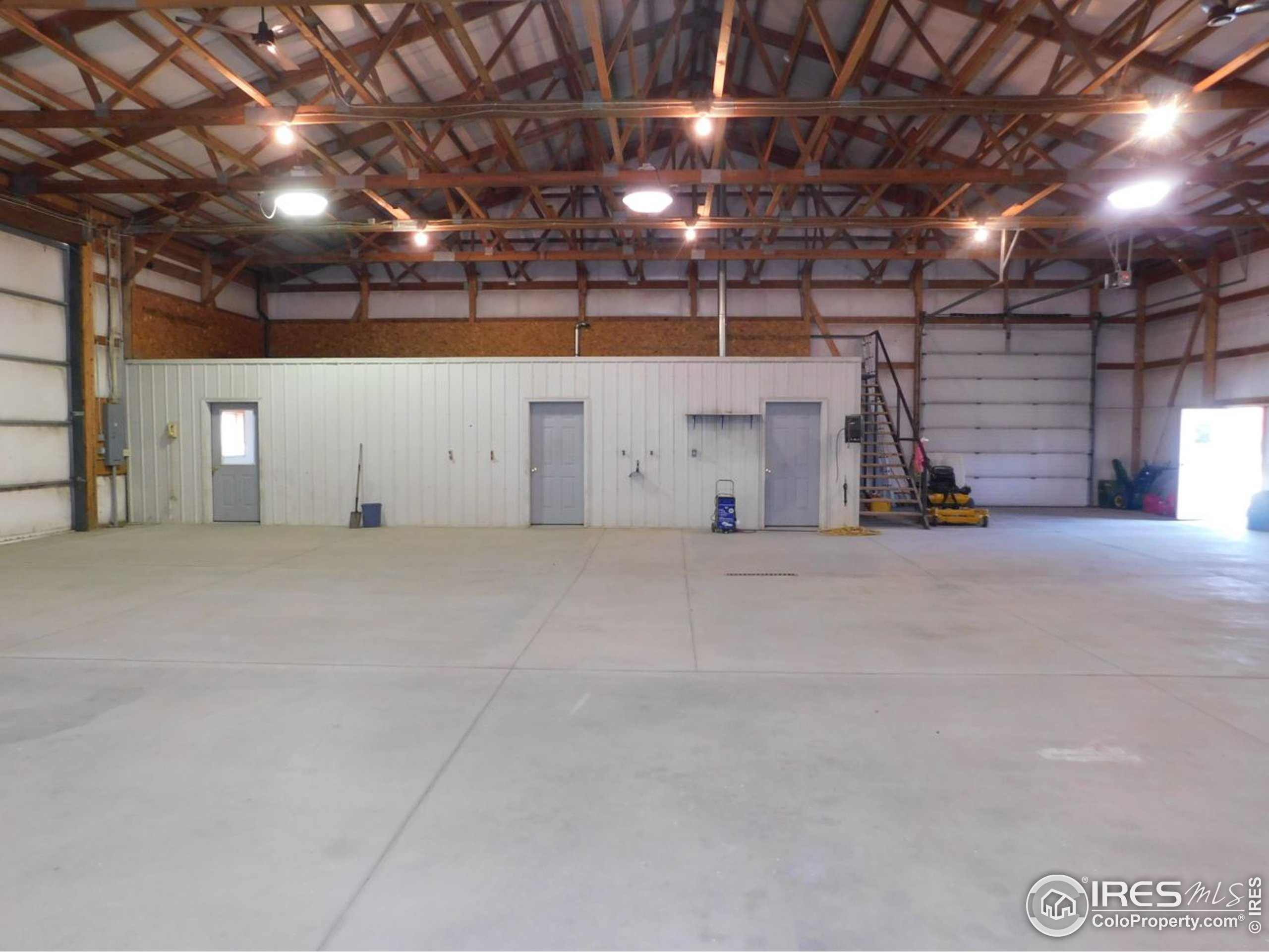 West end of shop with concrete, heat and breakroom/office w/ bathroom
