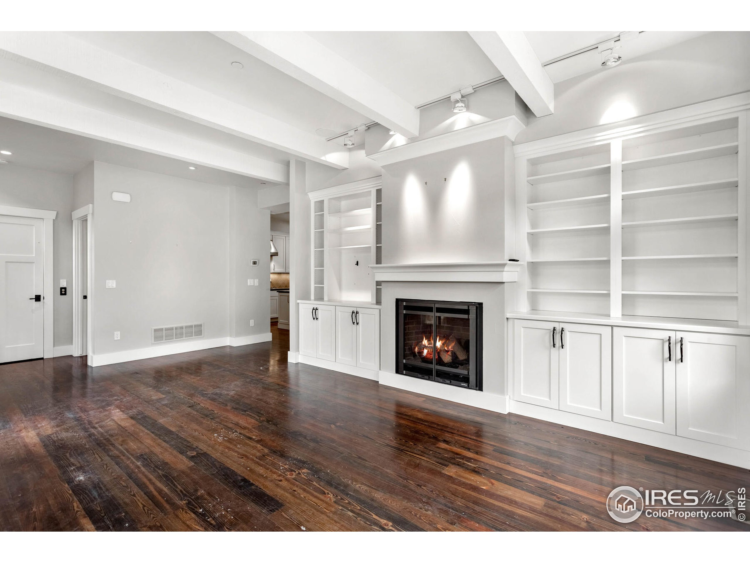 Incredible Design Features; Beamed Ceilings, Fireplace, Wood Trim, and More!