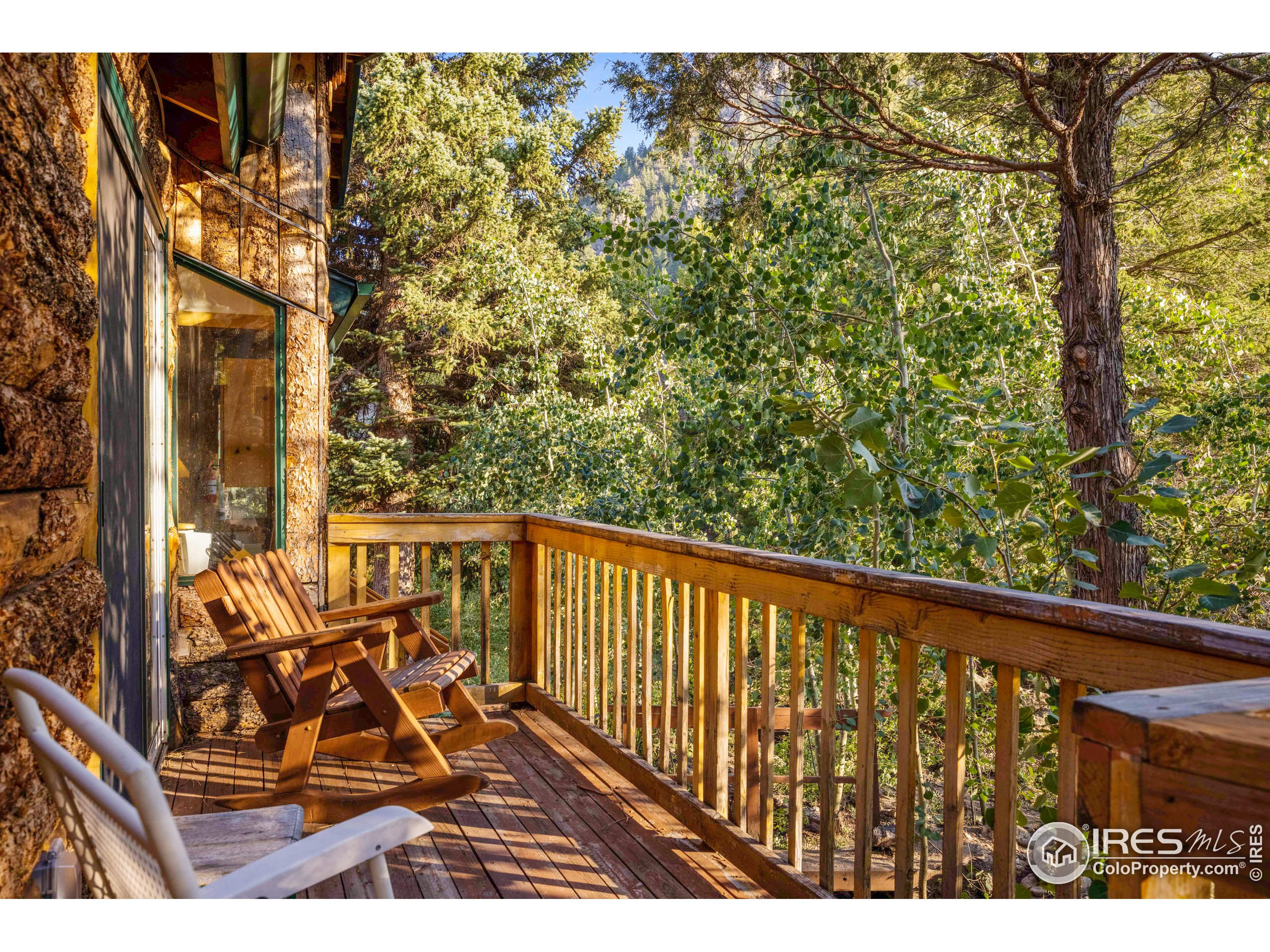 Primary Bedroom Deck in main Cabin with views of the stream