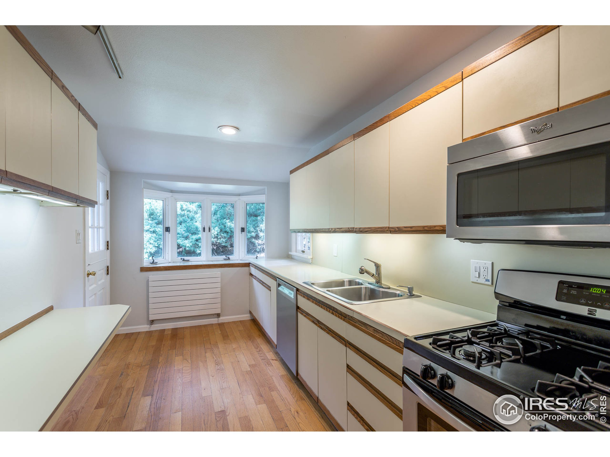 Kitchen with doors to backyard