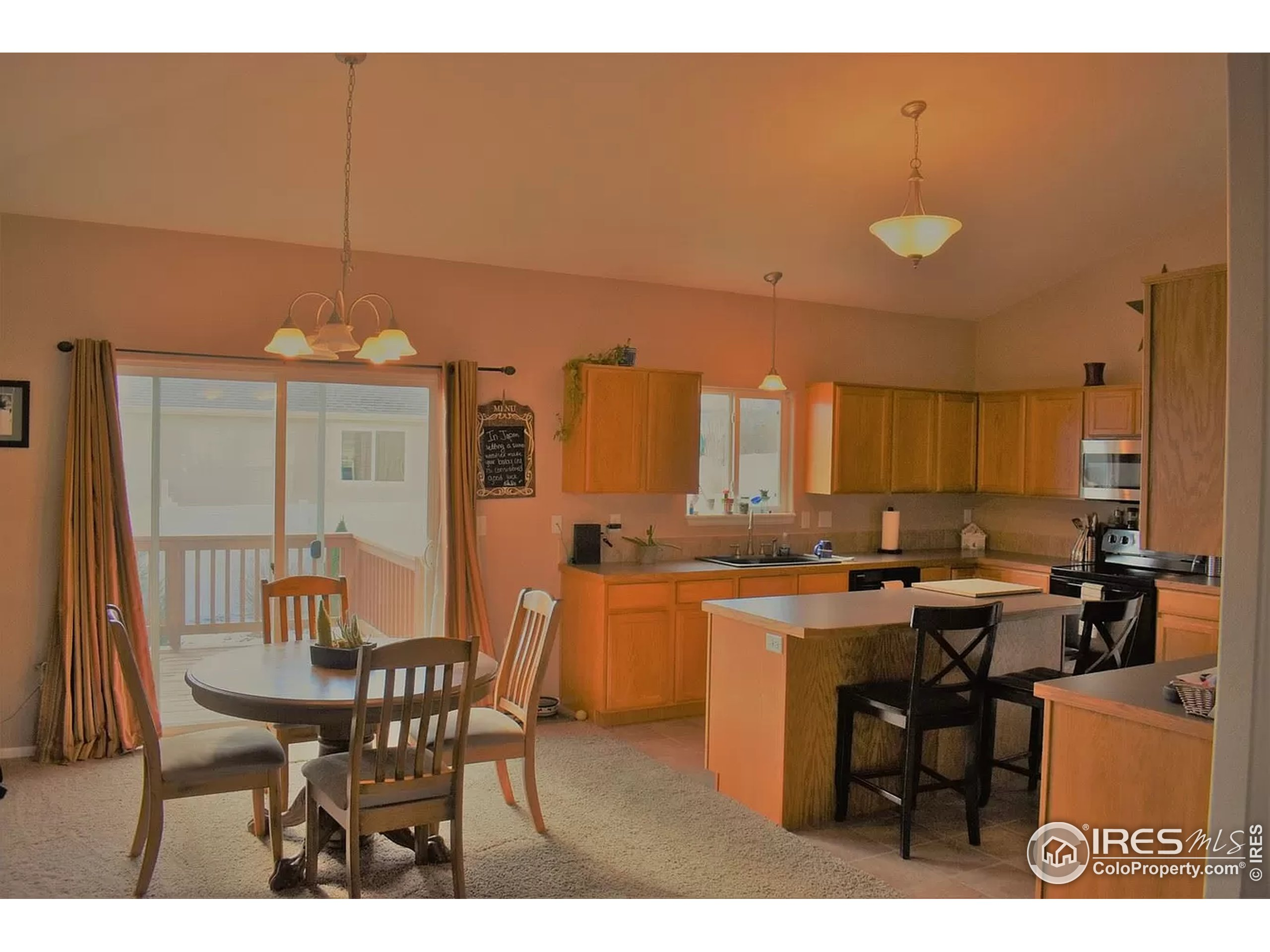 kitchen and dining area staged