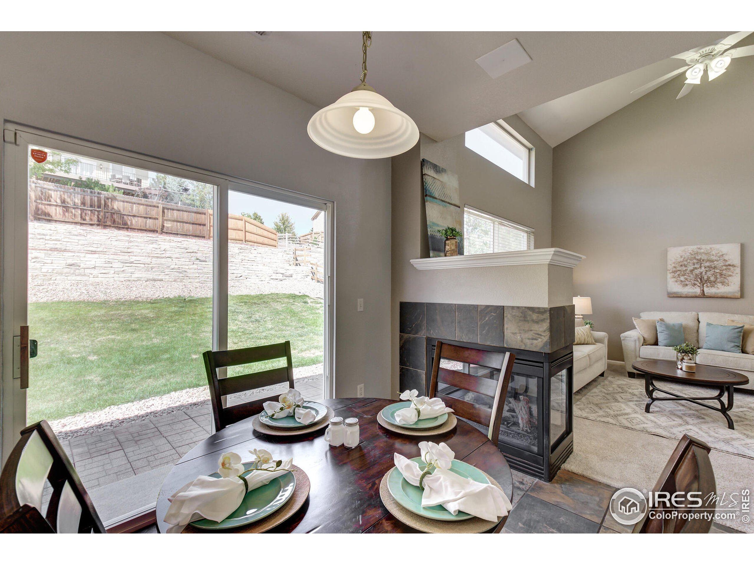Fireplace is 3-sided in living and dining room