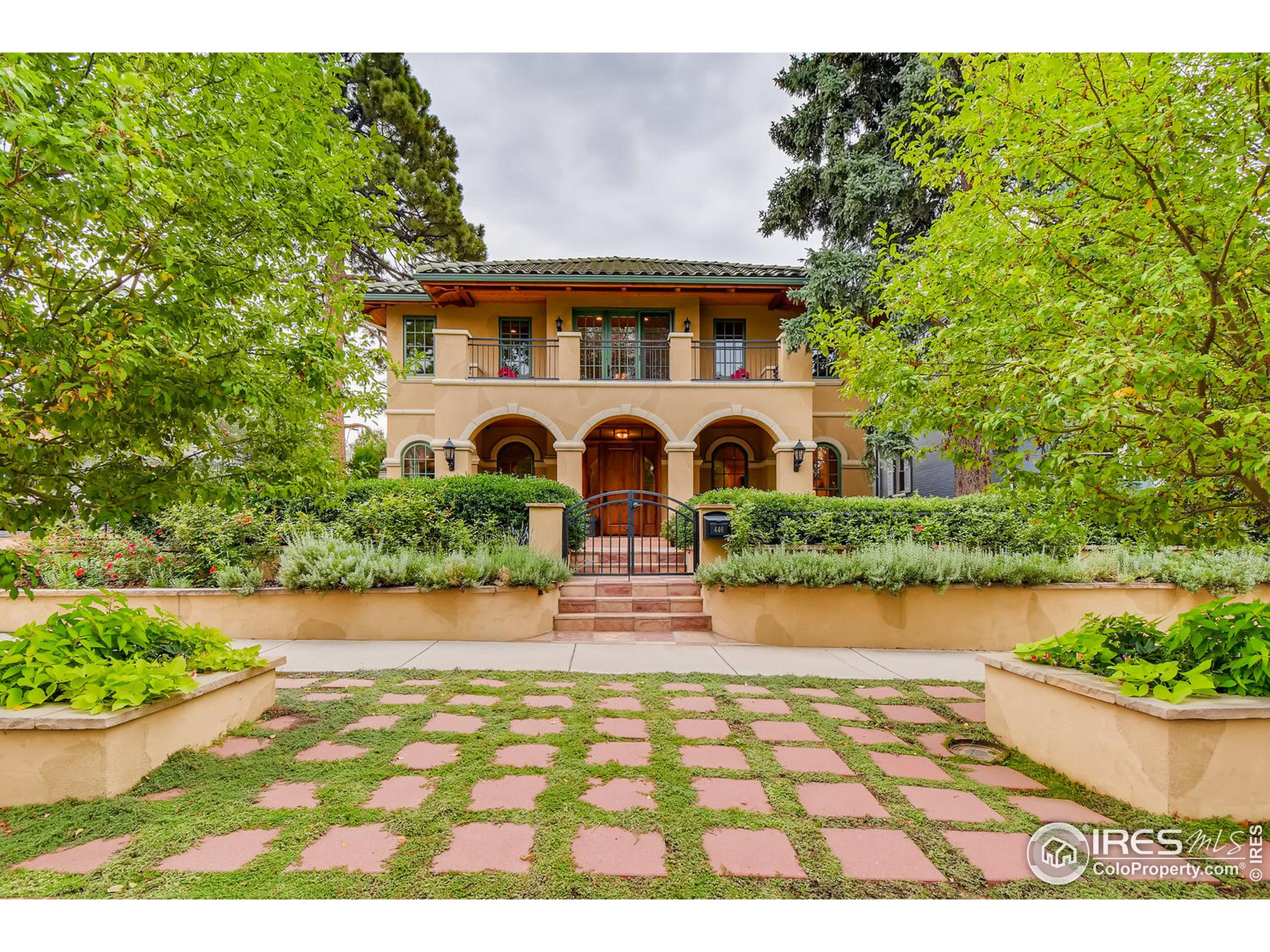 Walk beneath a striking colonnade into this stunning home on one of the best blocks of Cherry Creek North. Be greeted by the warmth of Italianate plaster walls, romantic arched doorways and windows, and solid knotty Alder doors throughout. Built with the finest materials and craftsmanship, this welcoming house features spacious rooms including a formal dining room which seats 12 comfortably, a chef's dream kitchen with Wolf appliances and wet bar, 2 offices, 2 laundries, and a private courtyard with fire pit and fountain. Enjoy a whole house automated audiovisual system operating off your tablet or smart phone and a west-facing balcony for sunset viewing. Thresholdless construction; elevator to all levels; his + hers walk in closets, wine room; in-law area; oversized 3 car garage w/ potting bench and a dog run for the pooch.