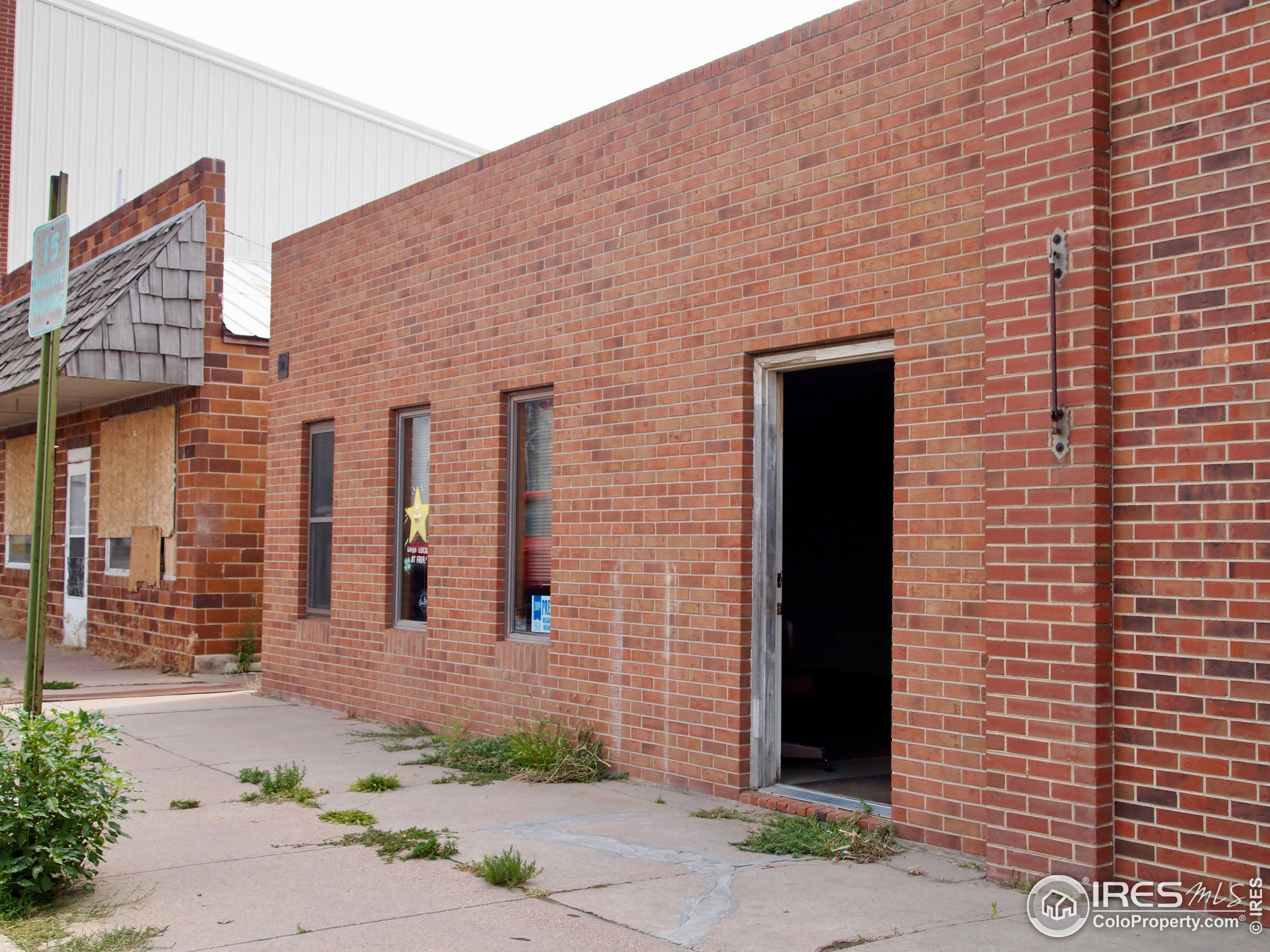 Front entrance, second building is on the left of this door. >>>