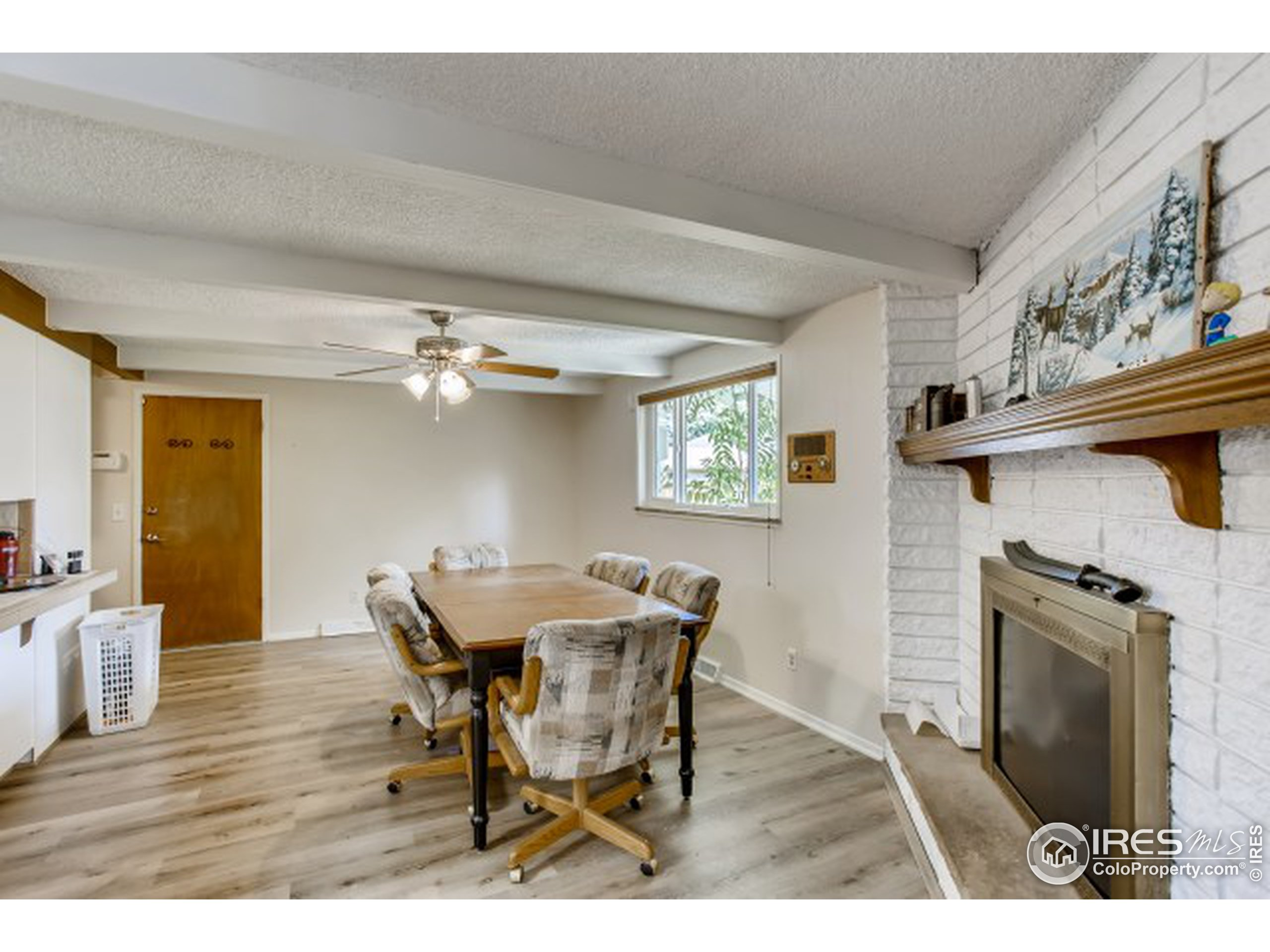 Dining Room with Fireplace. Attached 2 Car Garage