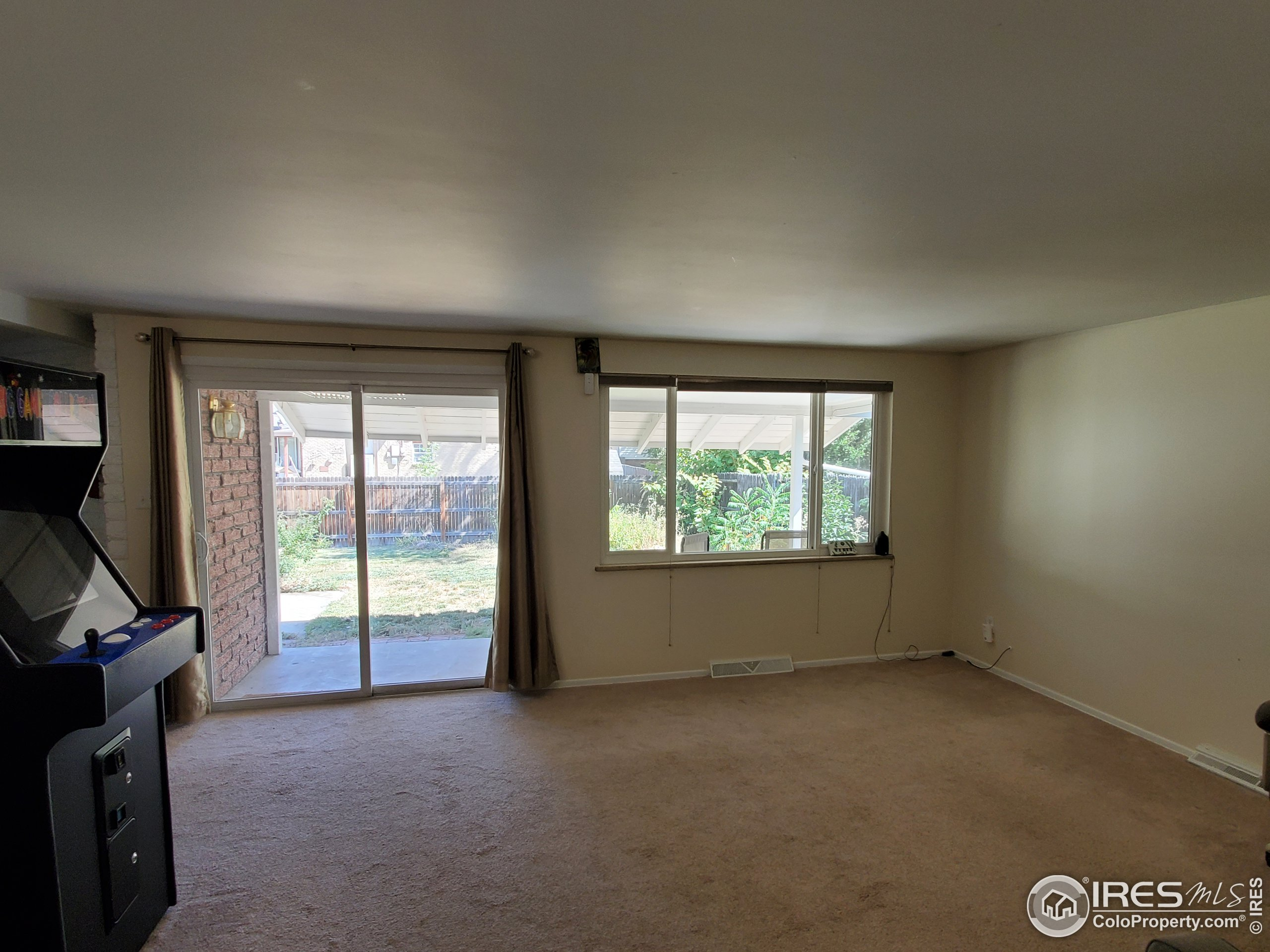 Living Room with Sliding Glass Door to Covered Patio