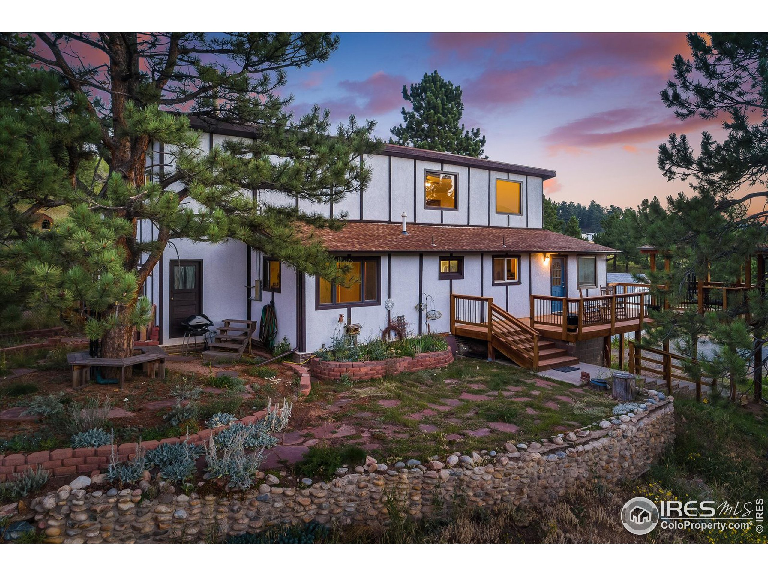 CO Mountain Hm nestled among the Evergreens. Front steps lead to lrg deck & Gazebo(great for your morning coffee)overlooking evergreens & flower filled meadows below. This hm-featuring laminate flrs, vaulted ceilings & beautiful flr to ceiling brick gas fireplace. Separate din area & remodeled kitch w/newer appls, corian cntertops & cntr seating greet you as you enter. Down the hall: 2 beds, shared full ba, laundry area w/antique laundry tub. Mid upper lvl w/lrg living rm accented w/gas fplc & built-ins for movie watching. Retire to en-suite primary rm w/3/4 remodel ba. French doors lead to private patio. Upper lvl- 2 flex areas-great for office, exercise rm-so many possibilities. Work from hm w/Century Link fiber optics-stay connected. Gazebo&decks for BBQ's&star gazing. Enjoy fenced area w/greenhouse, grow your all your favorites & chicken coop. Cnty maintained rds. Easy access Dnvr/Bldr/Golden, Eldora Ski Resort & Gross Dam Res. This home invites you to play where you live.