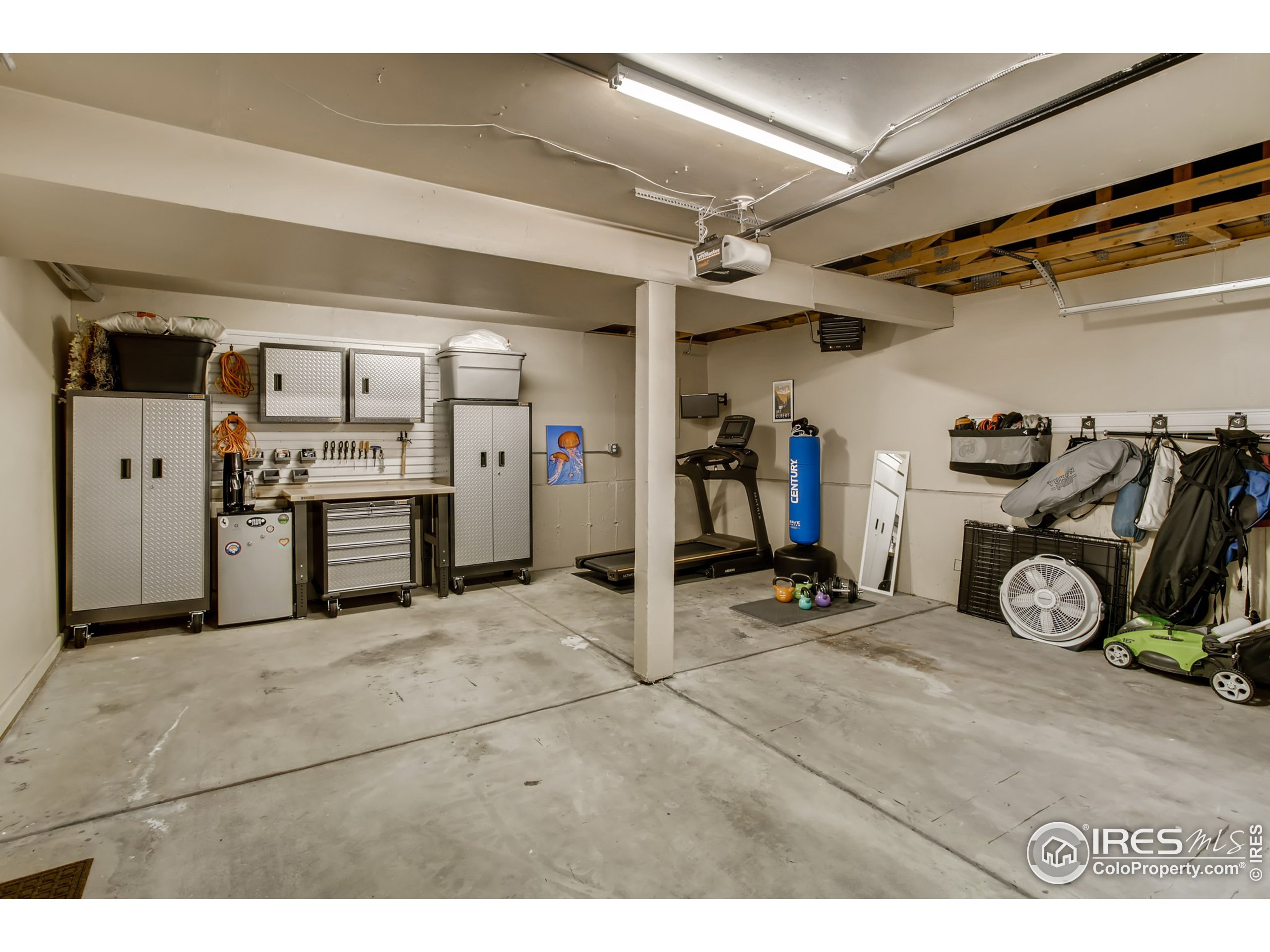 2 Car Attached Garage includes heater and Gladiator by Whirlpool Storage System