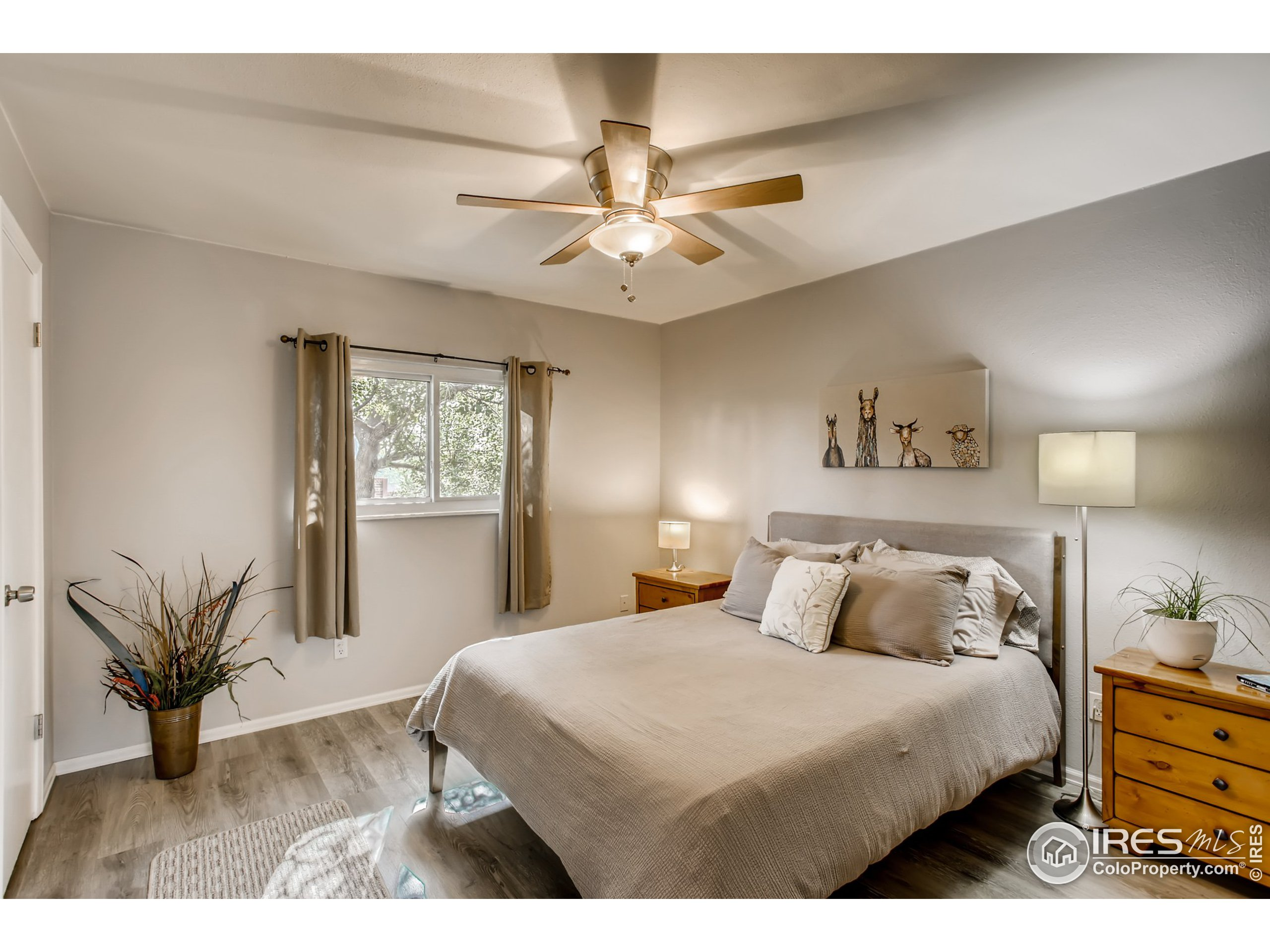 Primary Bedroom on Upper Level with newer LVP Flooring and Walk-in Closet