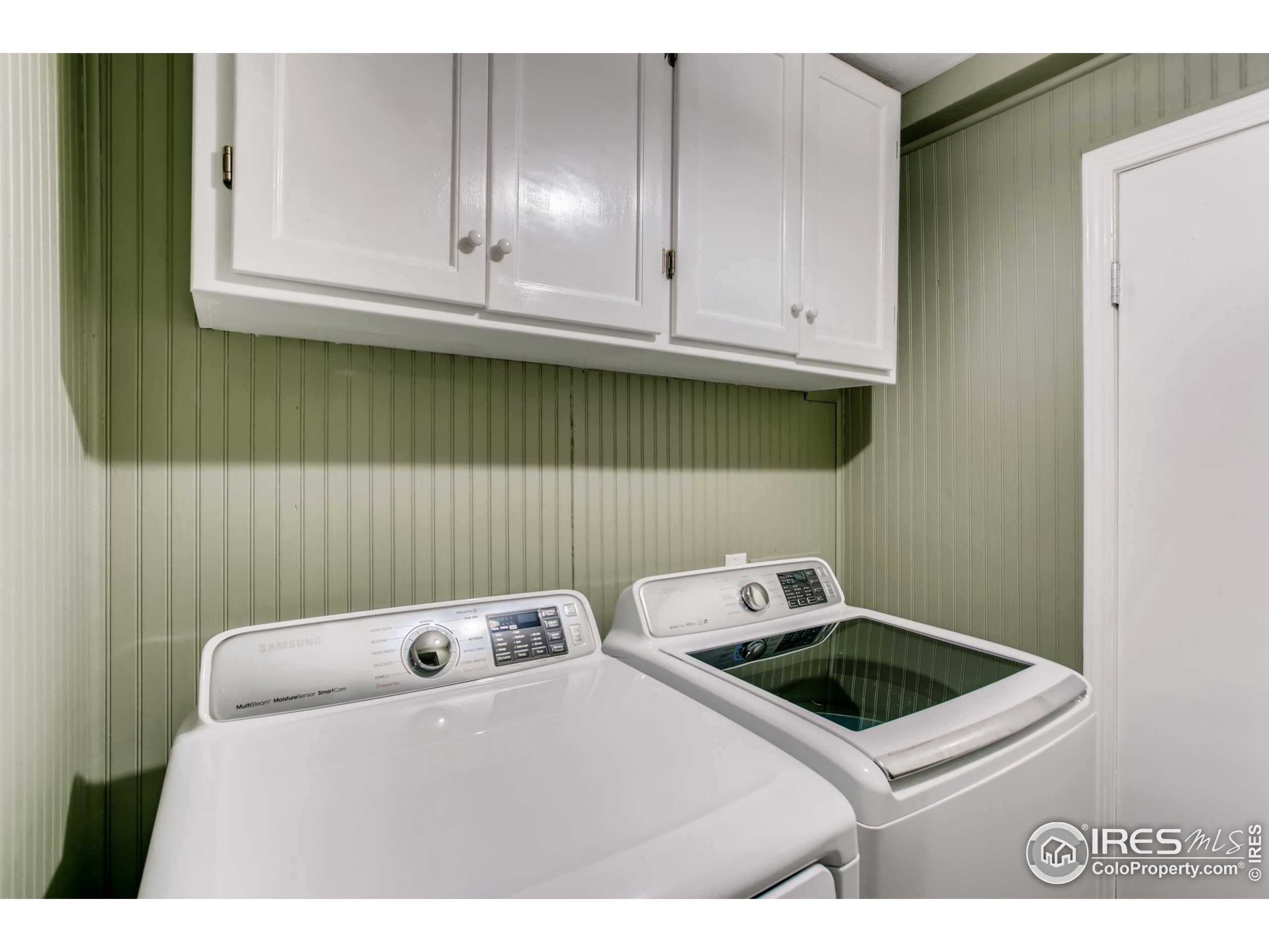 Laundry Room w/ Built-in Cabinets. Includes High Efficiency Washer/Dryer!