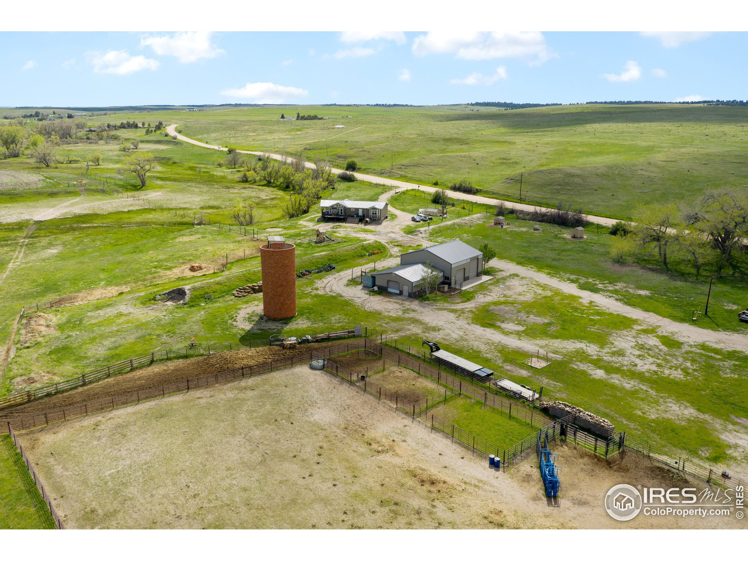 Corral: 3 Separate Pens With Water and Electricity and the staple of the property a freestanding brick silo