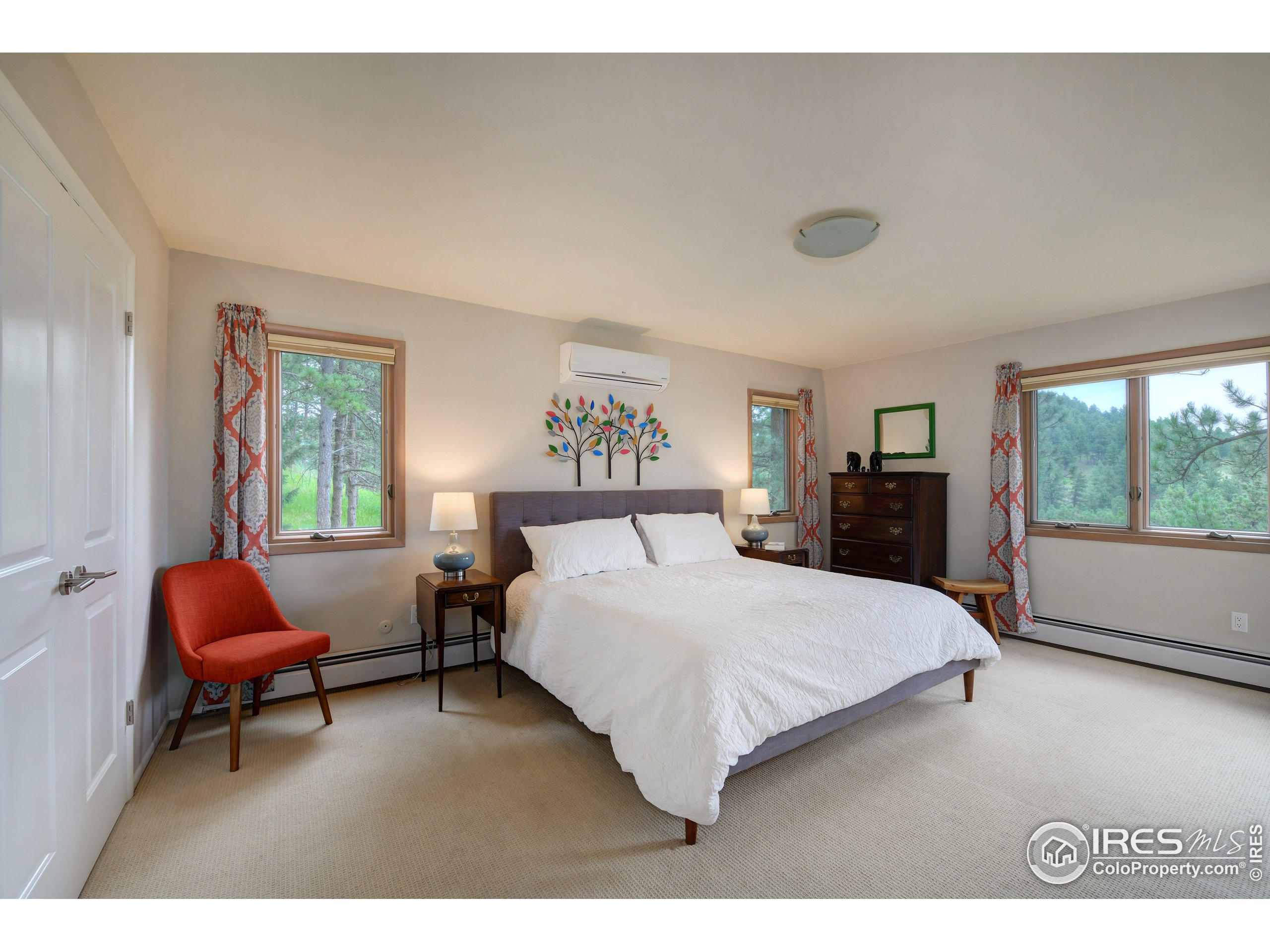Primary suite, surrounded by pines