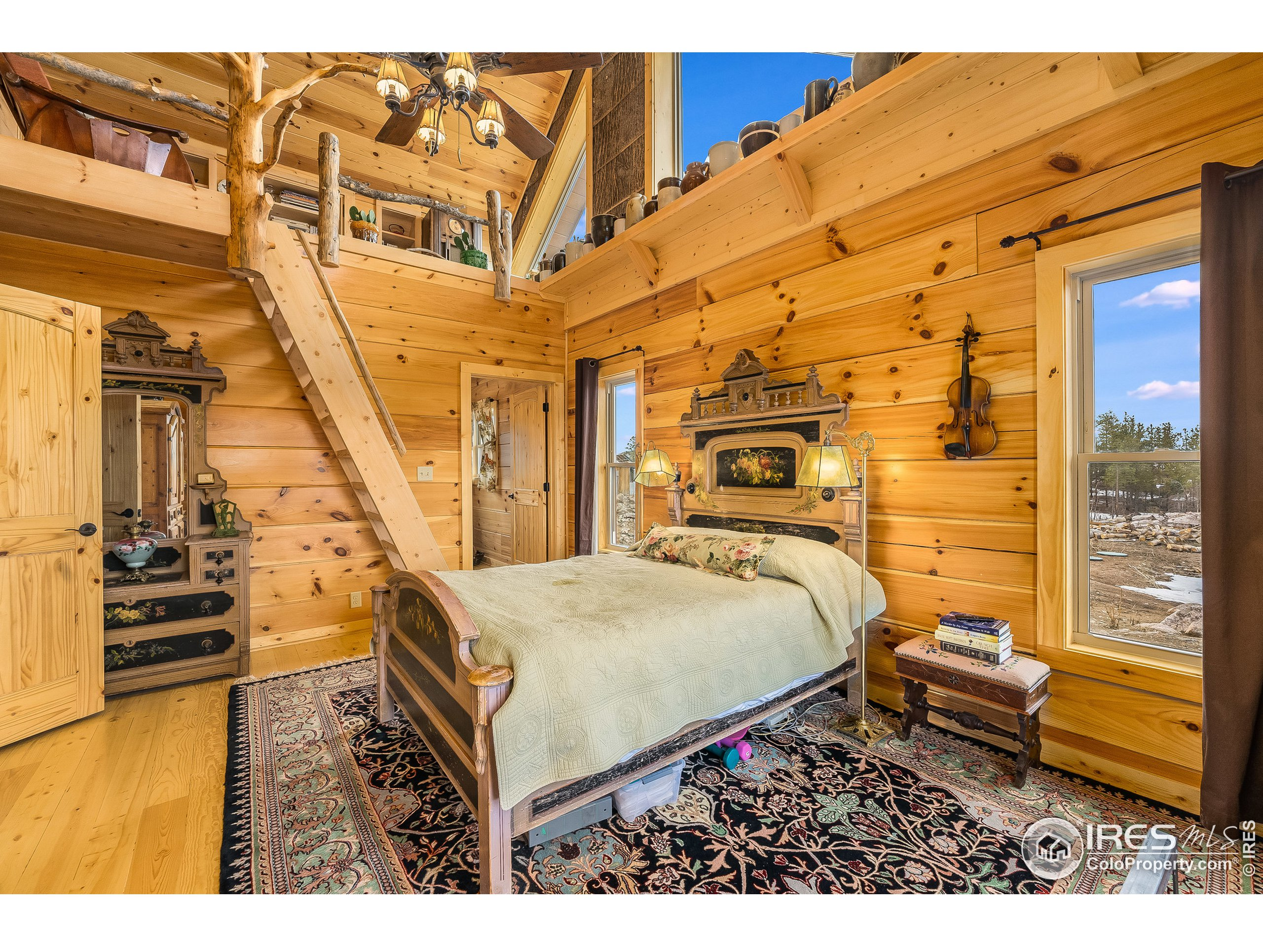 Master Bedroom With Treehouse reading Loft